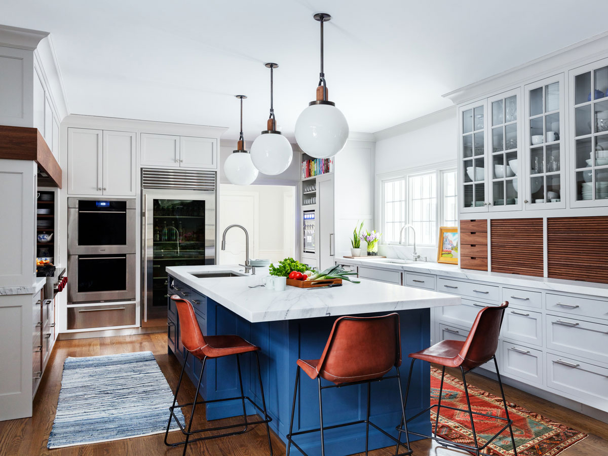 glass front refrigerator in blue, white, and red kitchen