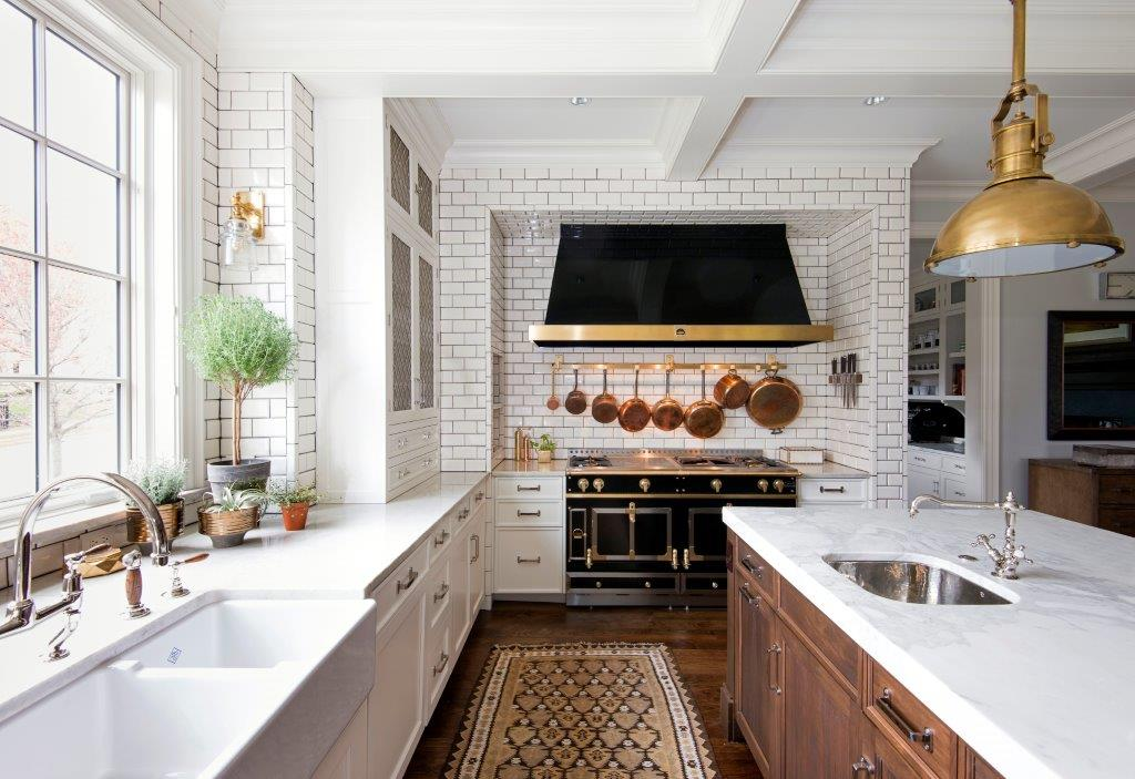 wide shot of white, black, and gold modern kitchen