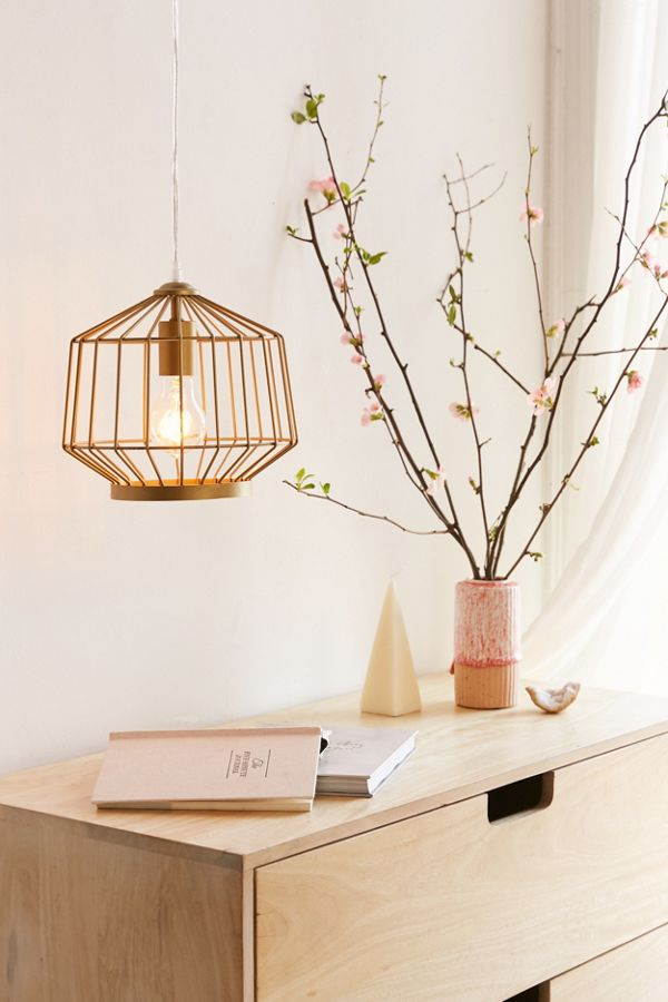 """Don't let the harsh dorm overheads be your only source of light. """"Plug-in pendant lights are everything,"""" Richardson says. """"Find a really cool one or two and hang those babies."""" They'll add coziness and major ambience to your space. We like this chic brass light from Urban Outfitters."""