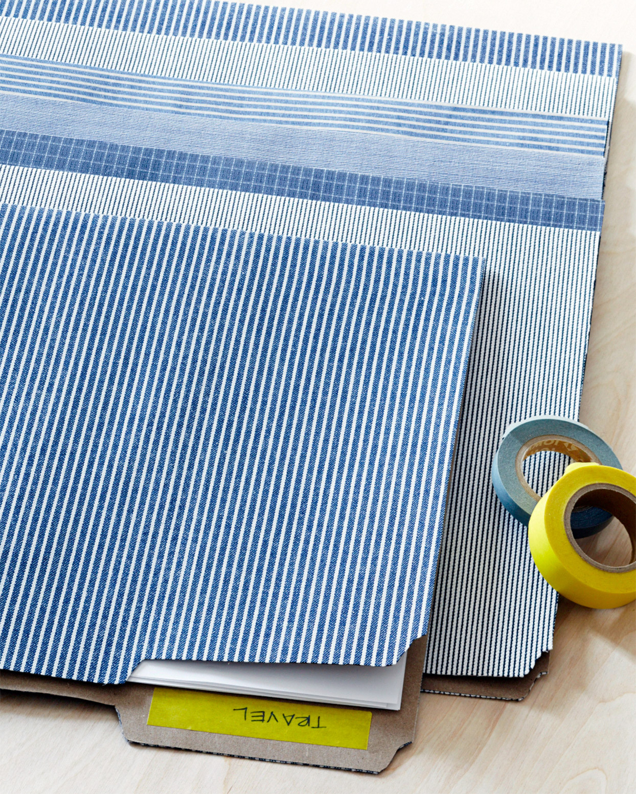 blue striped fabric-covered folders
