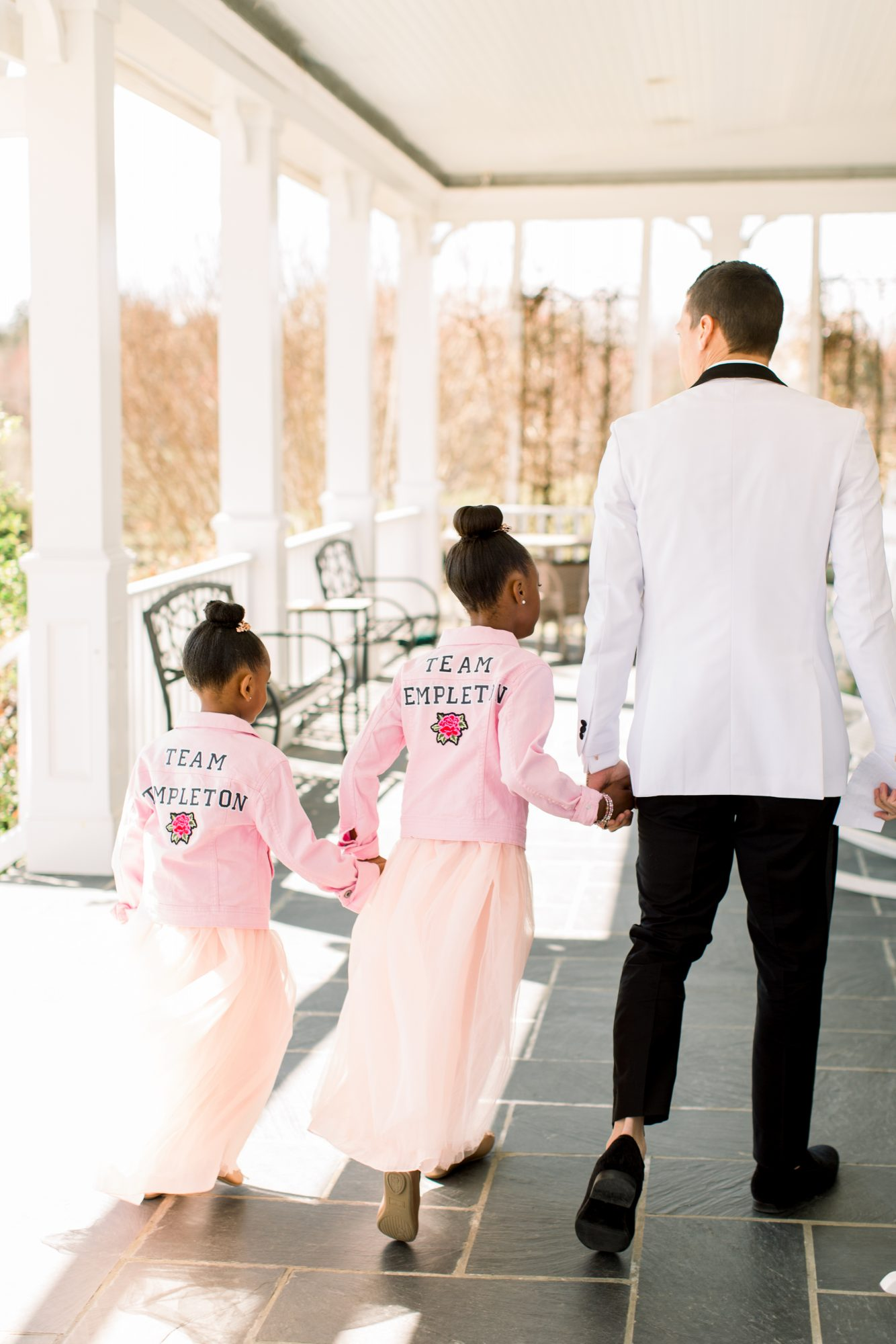 michelle nathan wedding groom walking with flower girls
