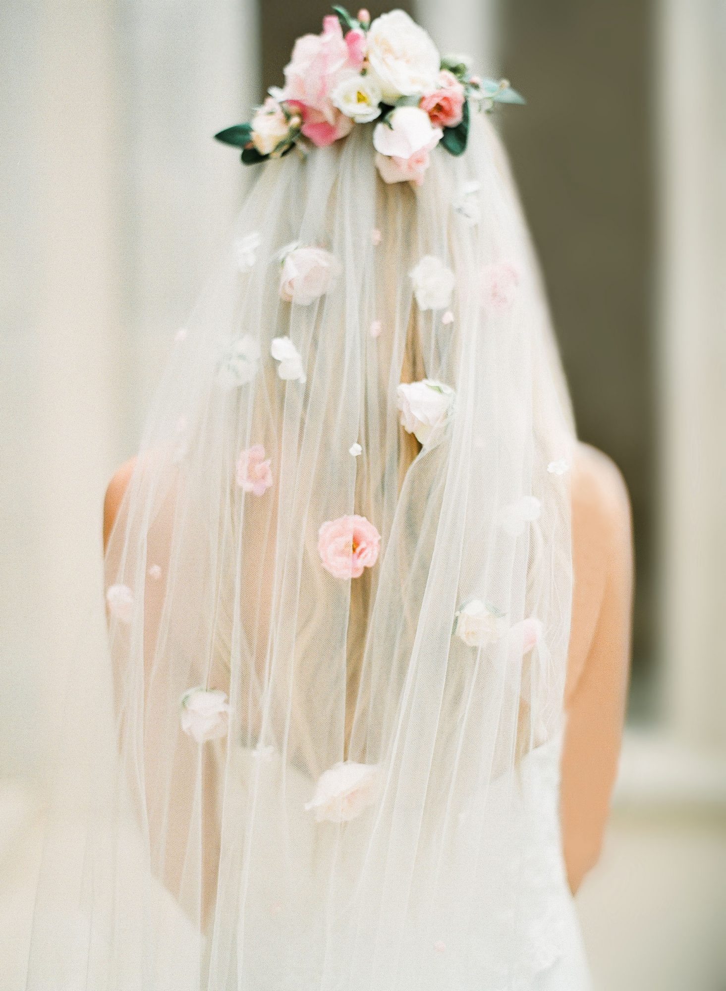 bride wearing short veil with fabric flowers