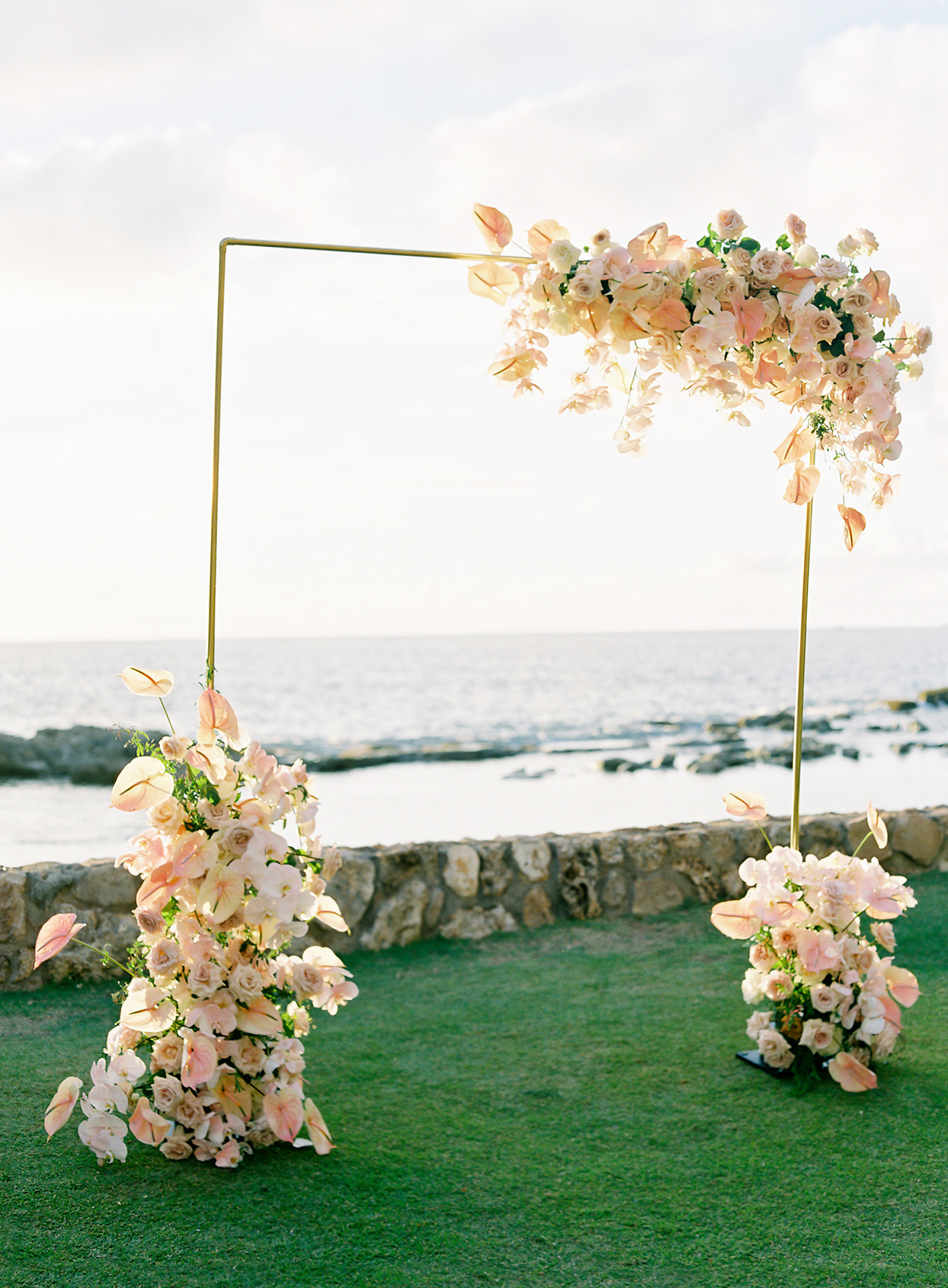 azuki sam wedding ceremony arch peach flowers