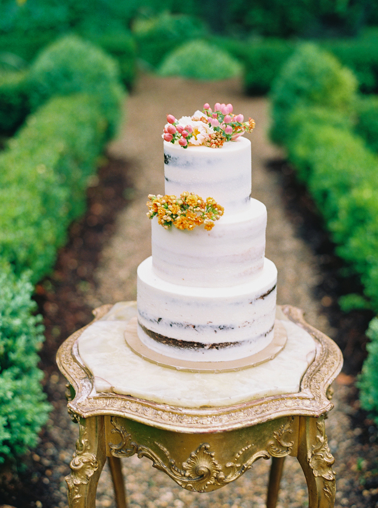 ashley scott wedding cake with flower bud decorations