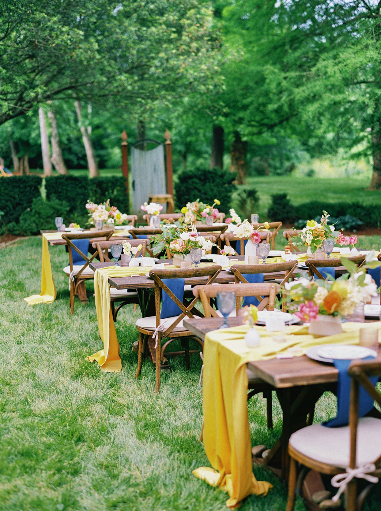 ashley scott rustic wedding reception tables on lawn