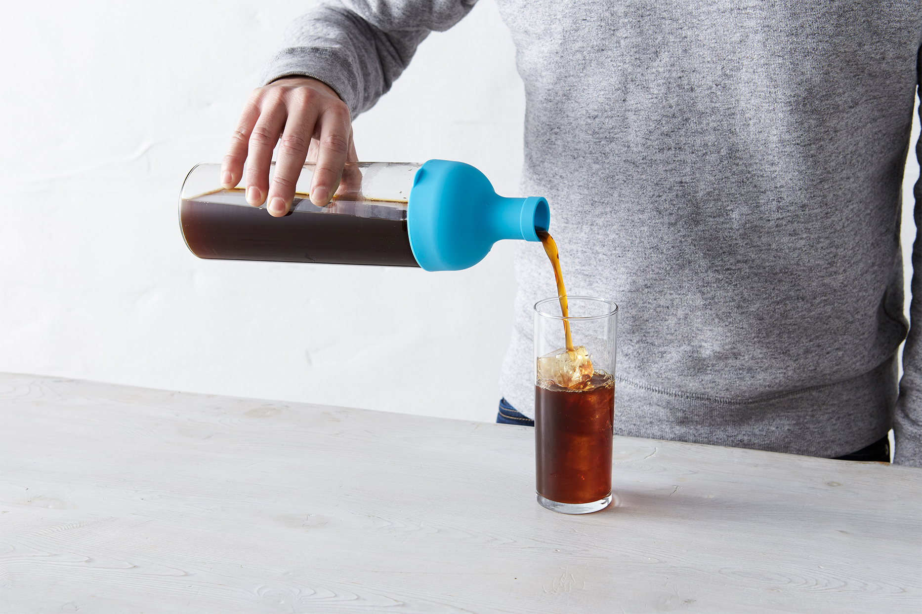 pouring coffee from cold brew maker
