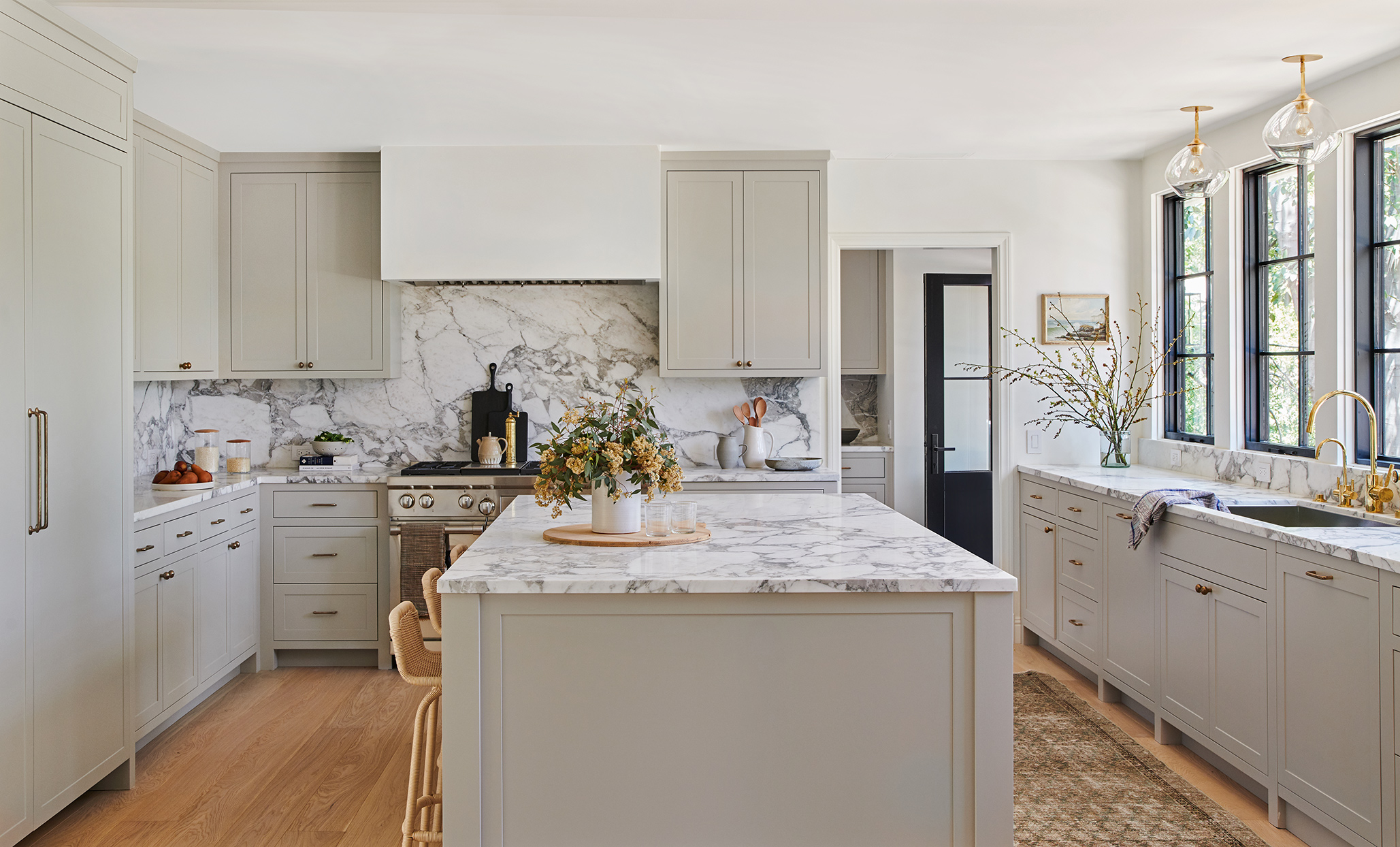 marble counter top and backsplash neutral color kitchen