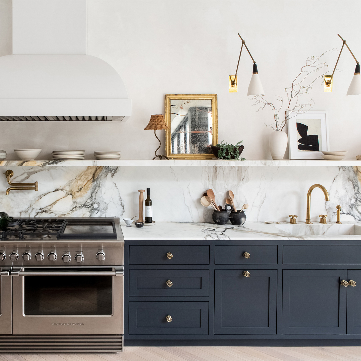 marble backsplash navy cabinets