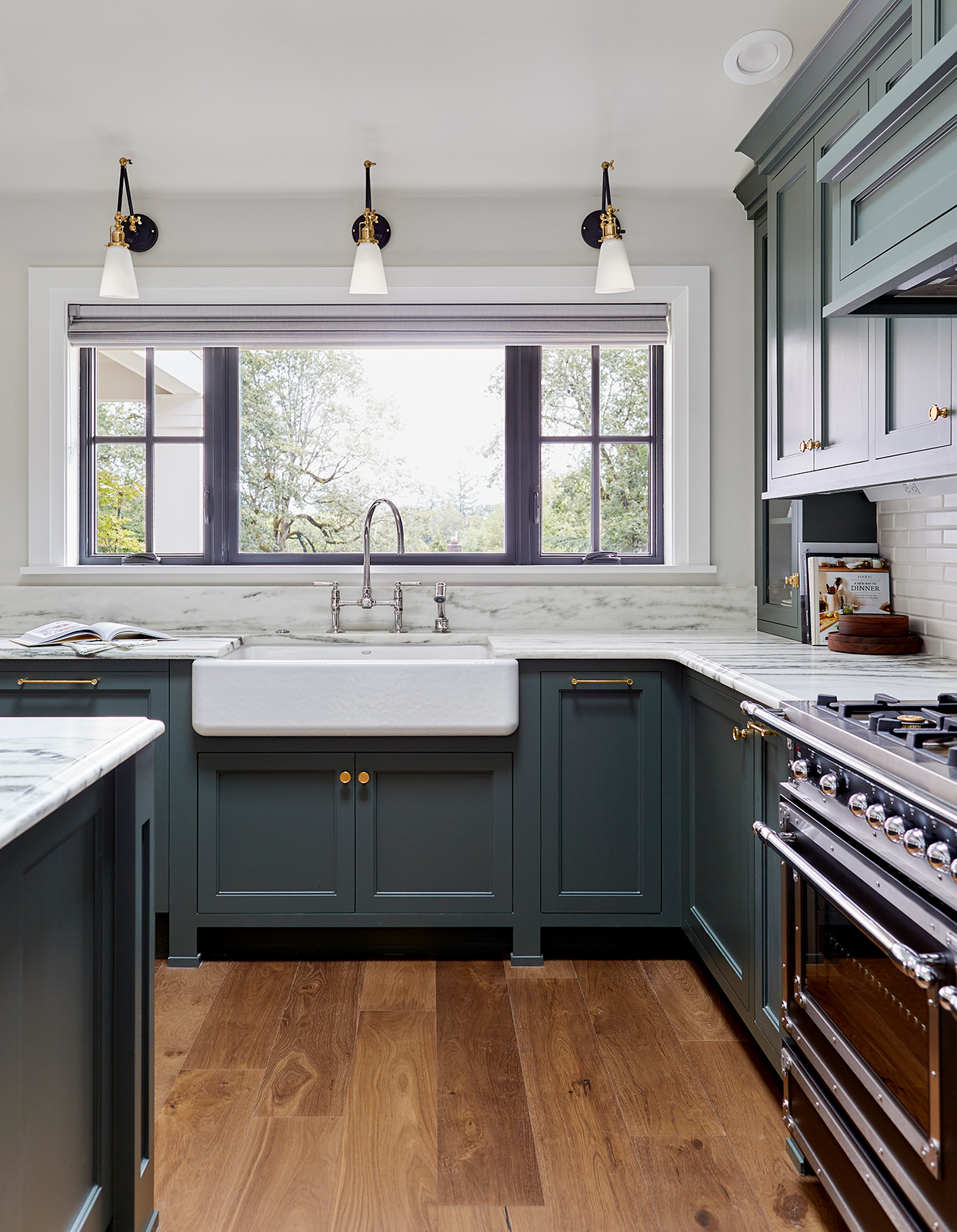 short delicate marble backsplash deep teal cabinets