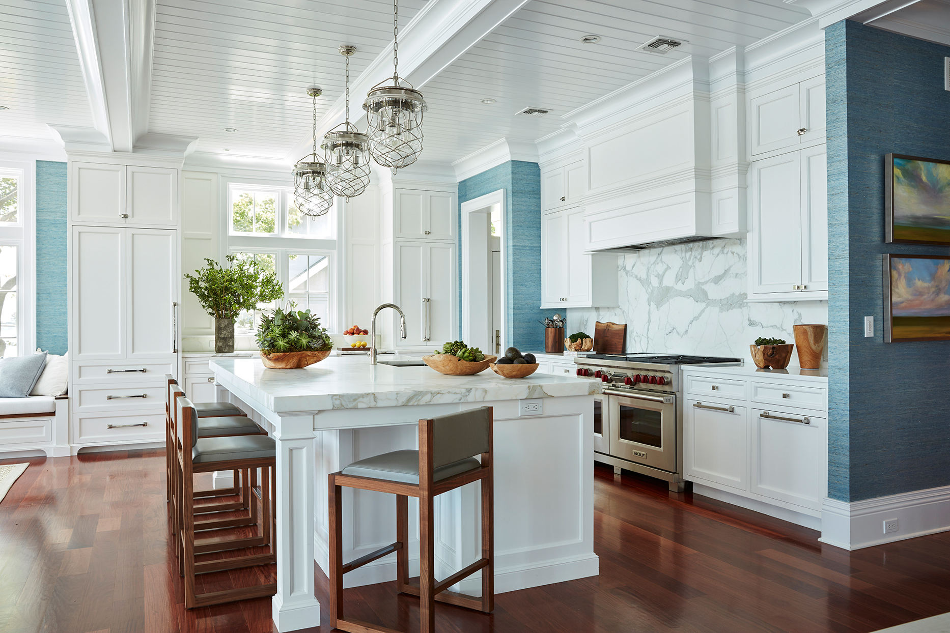 white marble backsplash in blue kitchen