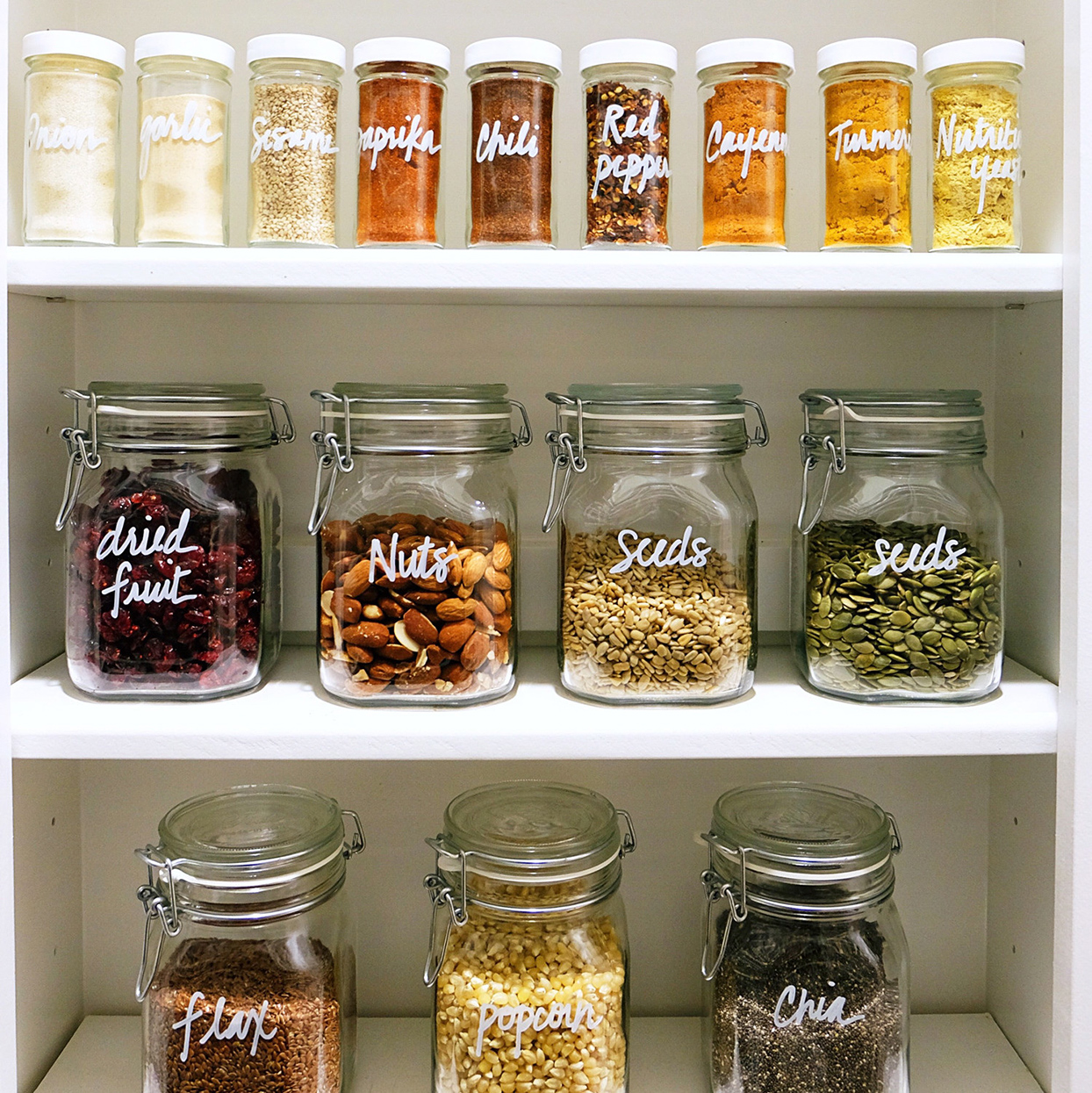 labelled glass canisters in pantry