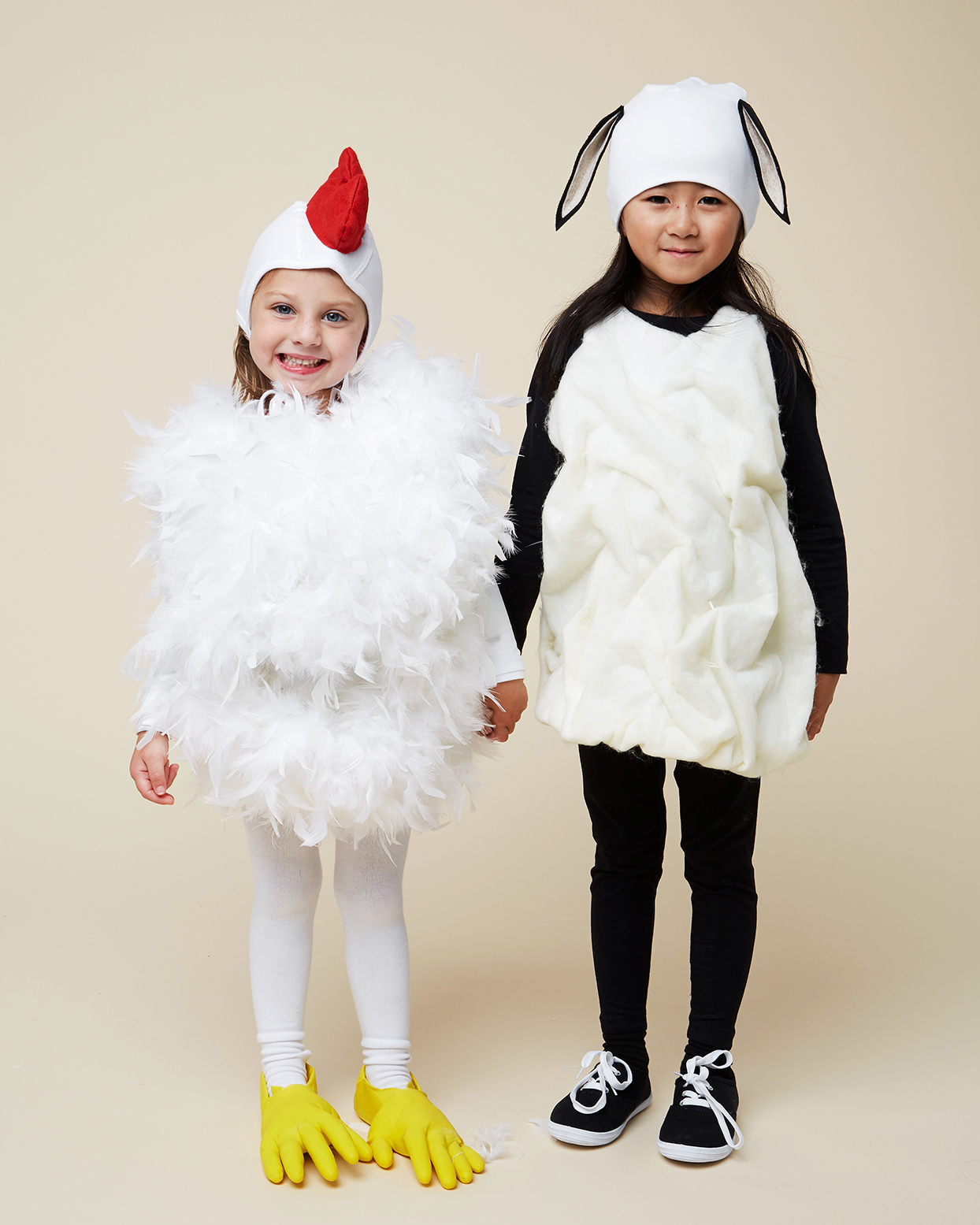 two kids in lamb and chicken costumes