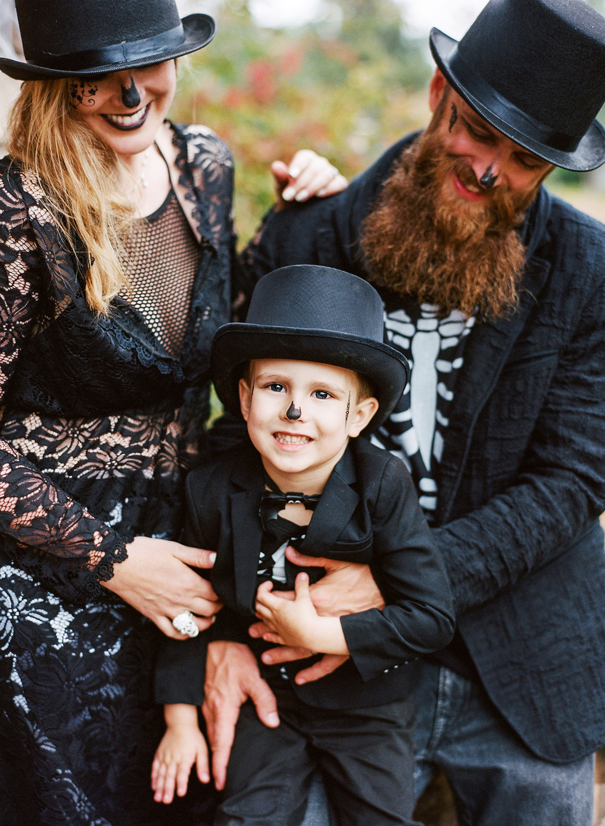 family in halloween masquerade costumes
