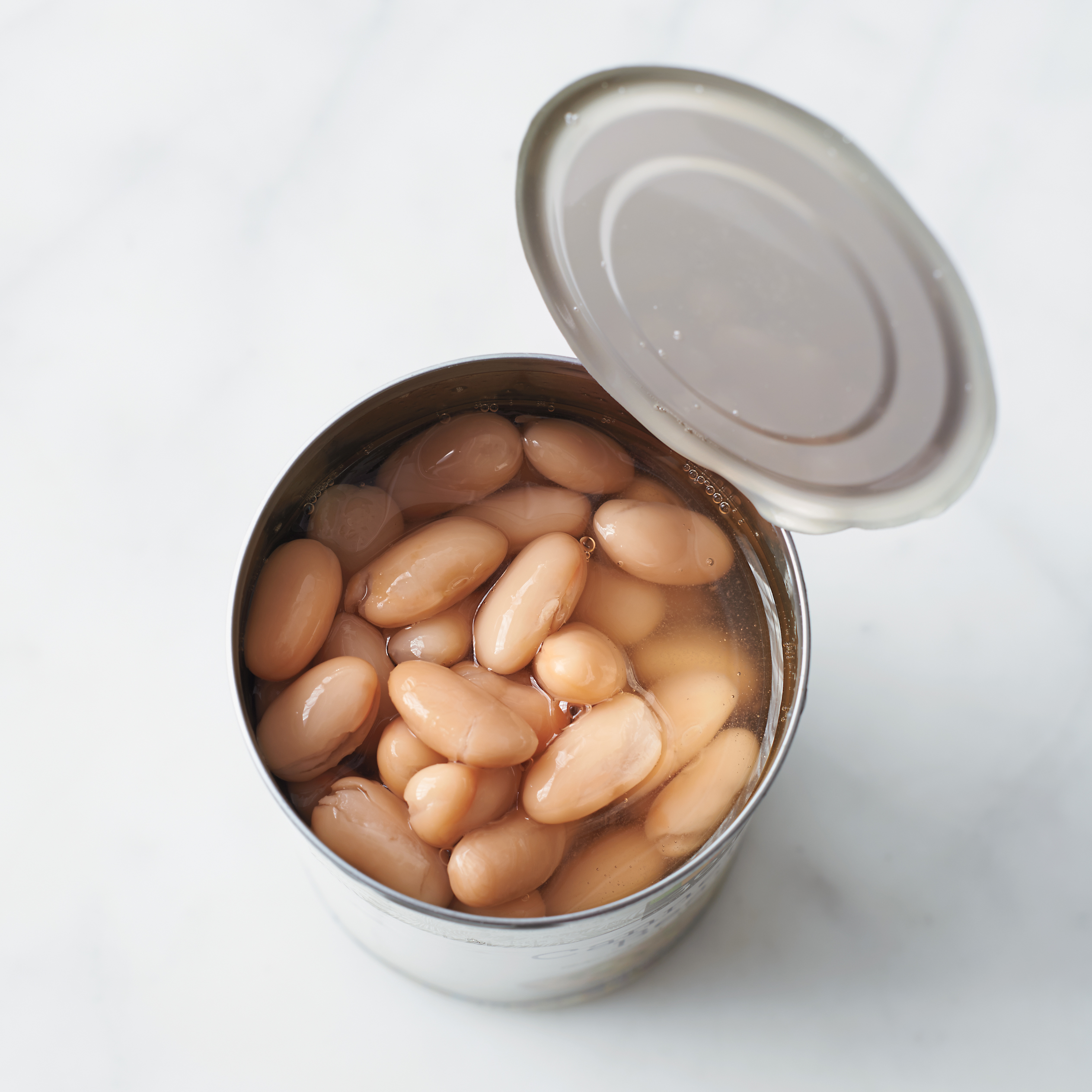 opened can of white beans