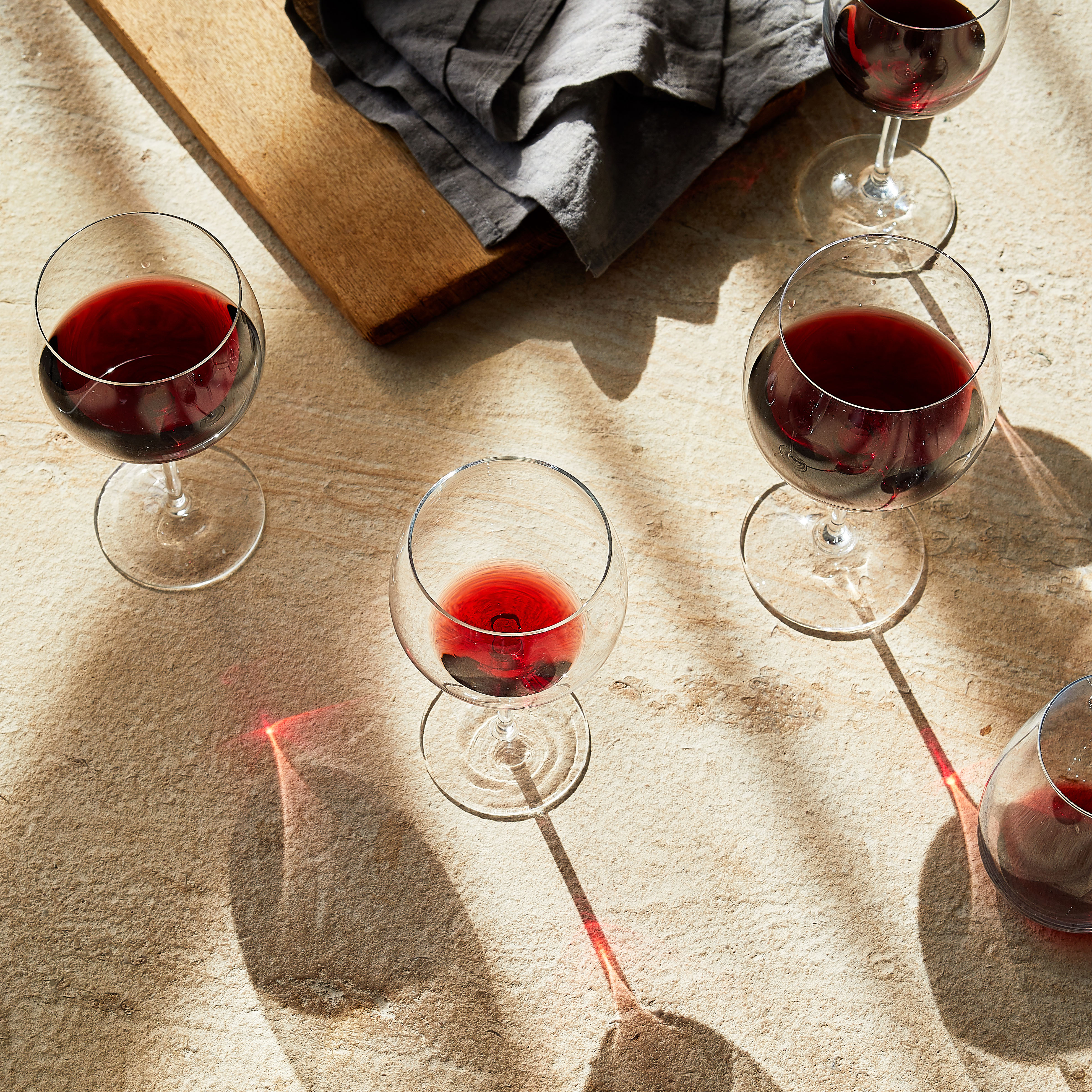 red wines in glasses on table