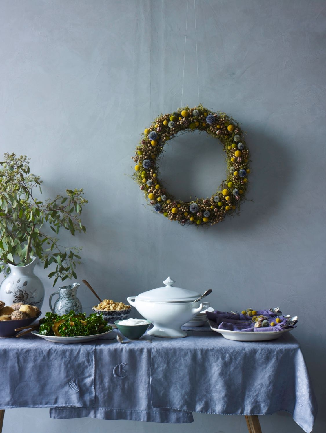 dried wreath above a buffet table