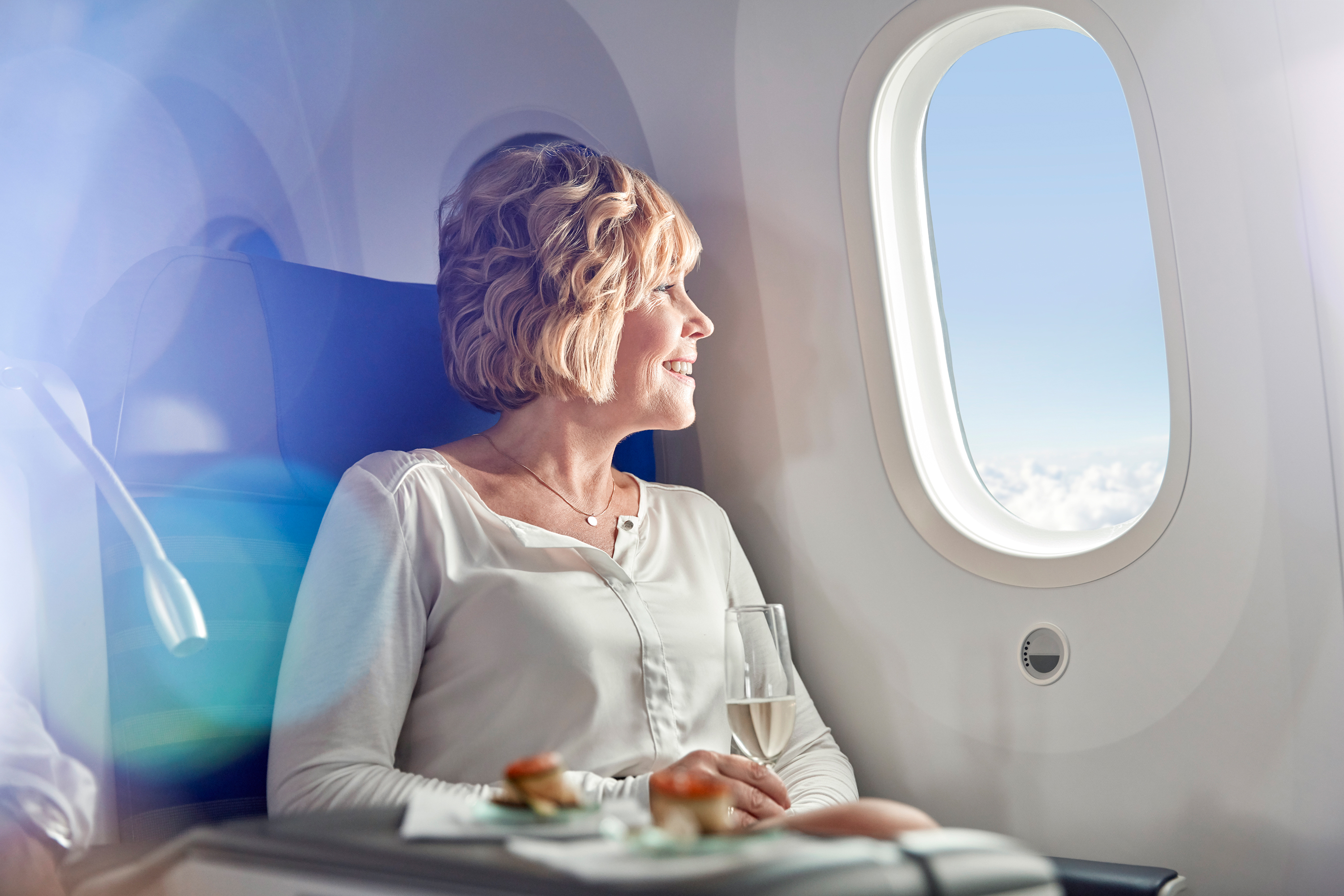 Woman Flying in Premium First Class Airplane Seat