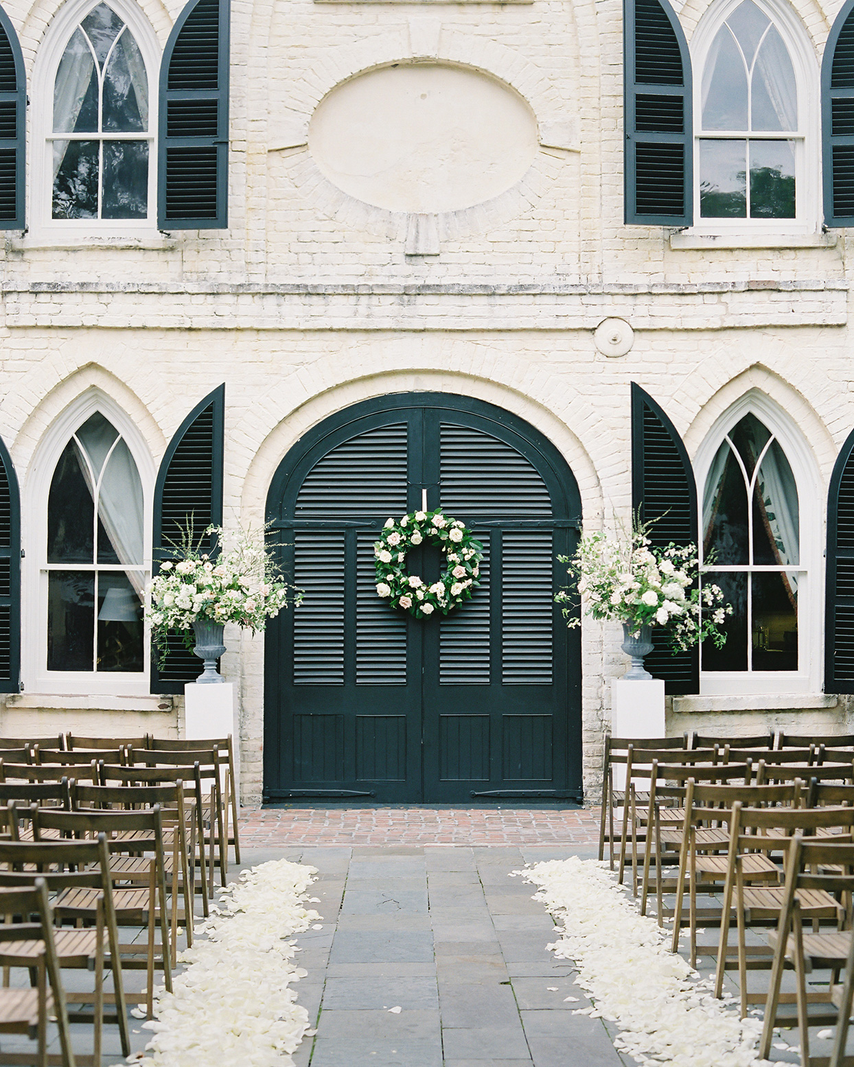 paula terence wedding ceremony location black doors with wreath