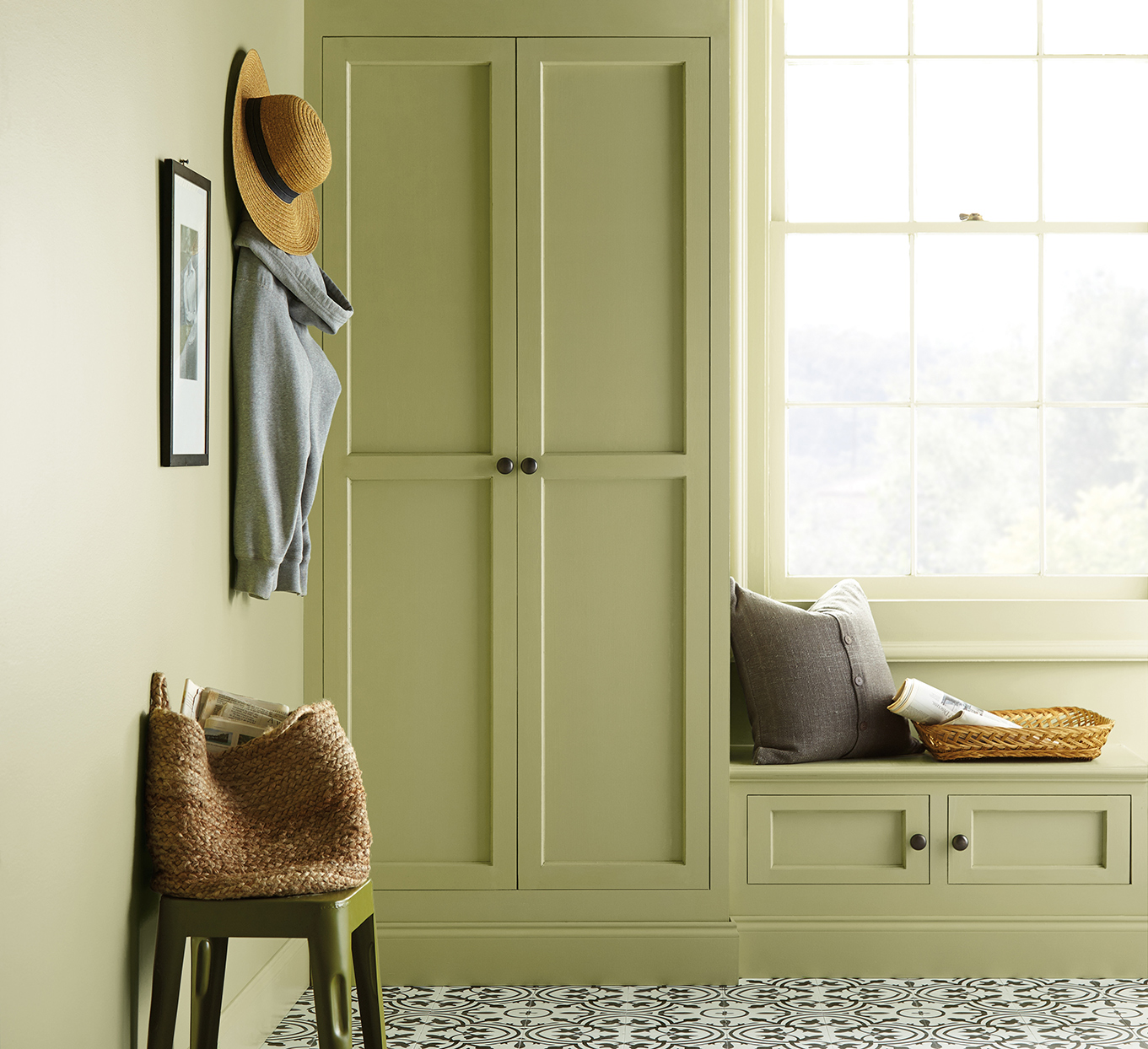 sage green cabinet and window seat with sun shining