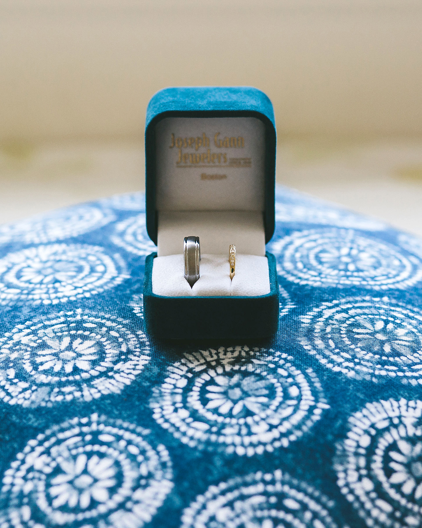 bride groom wedding bands in blue box