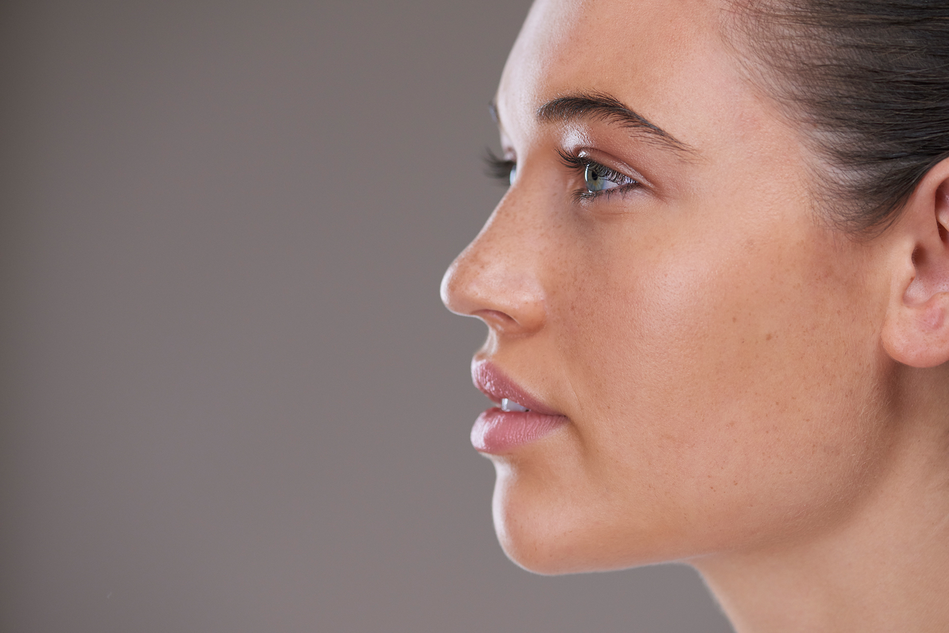 close up side profile of woman with good skin