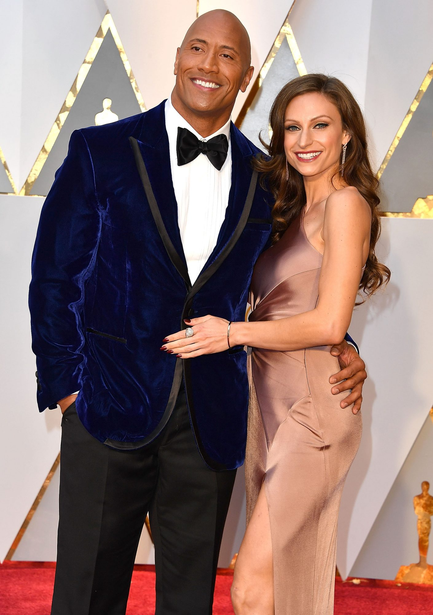 dwayne johnson and lauren hashian on red carpet