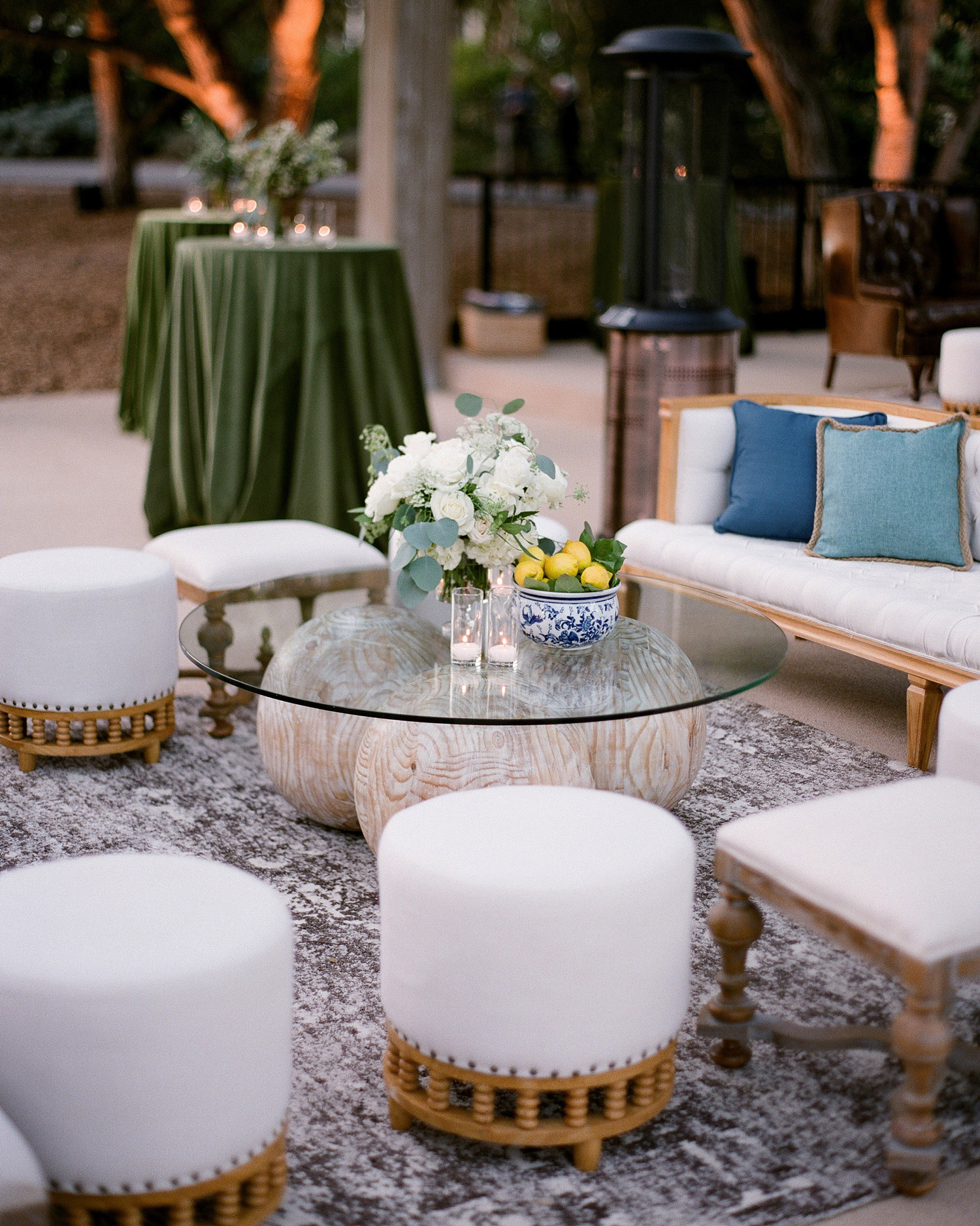 reception lounge glass table white stools