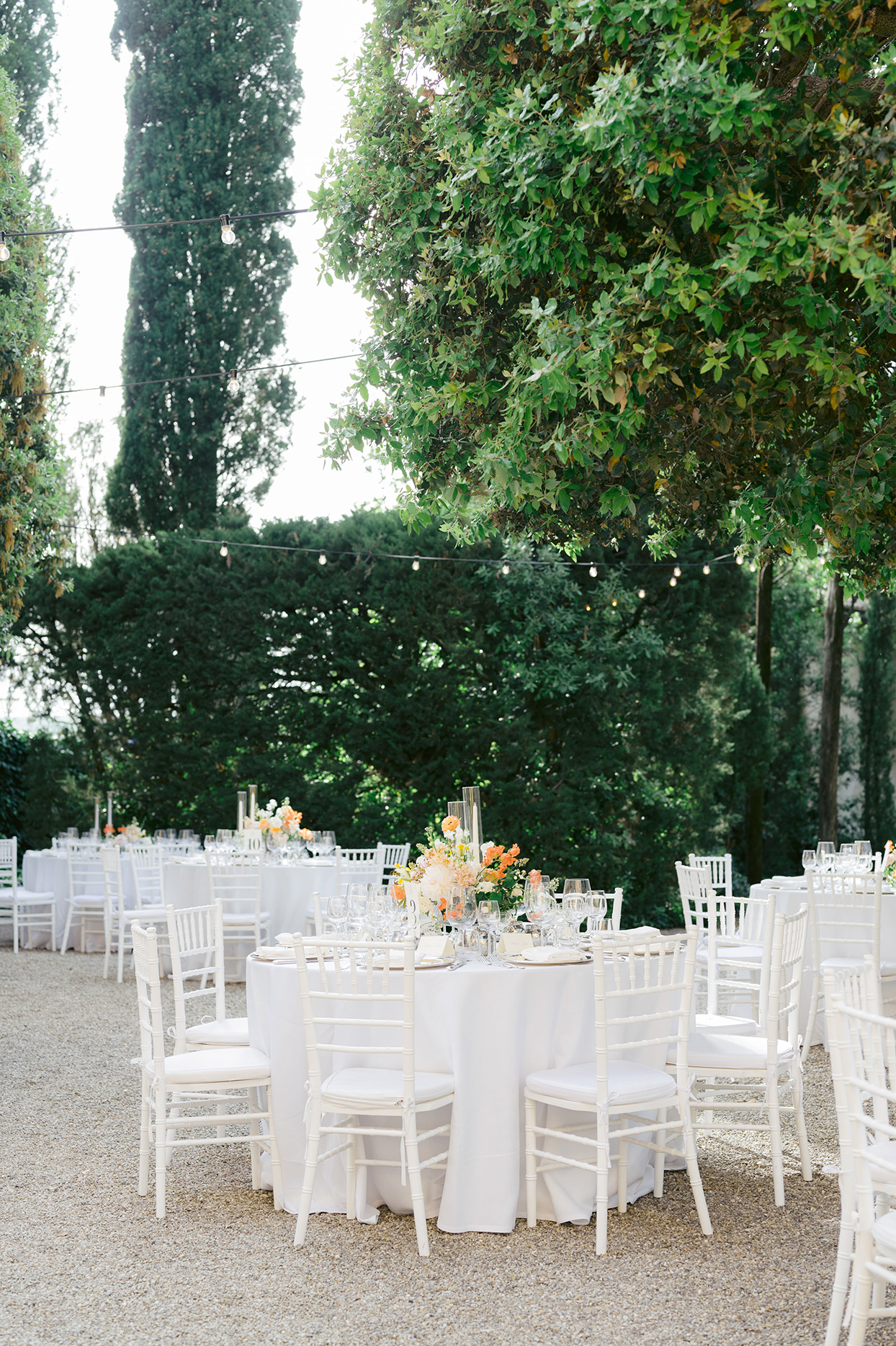 jennifer tobias wedding reception white tables and chairs