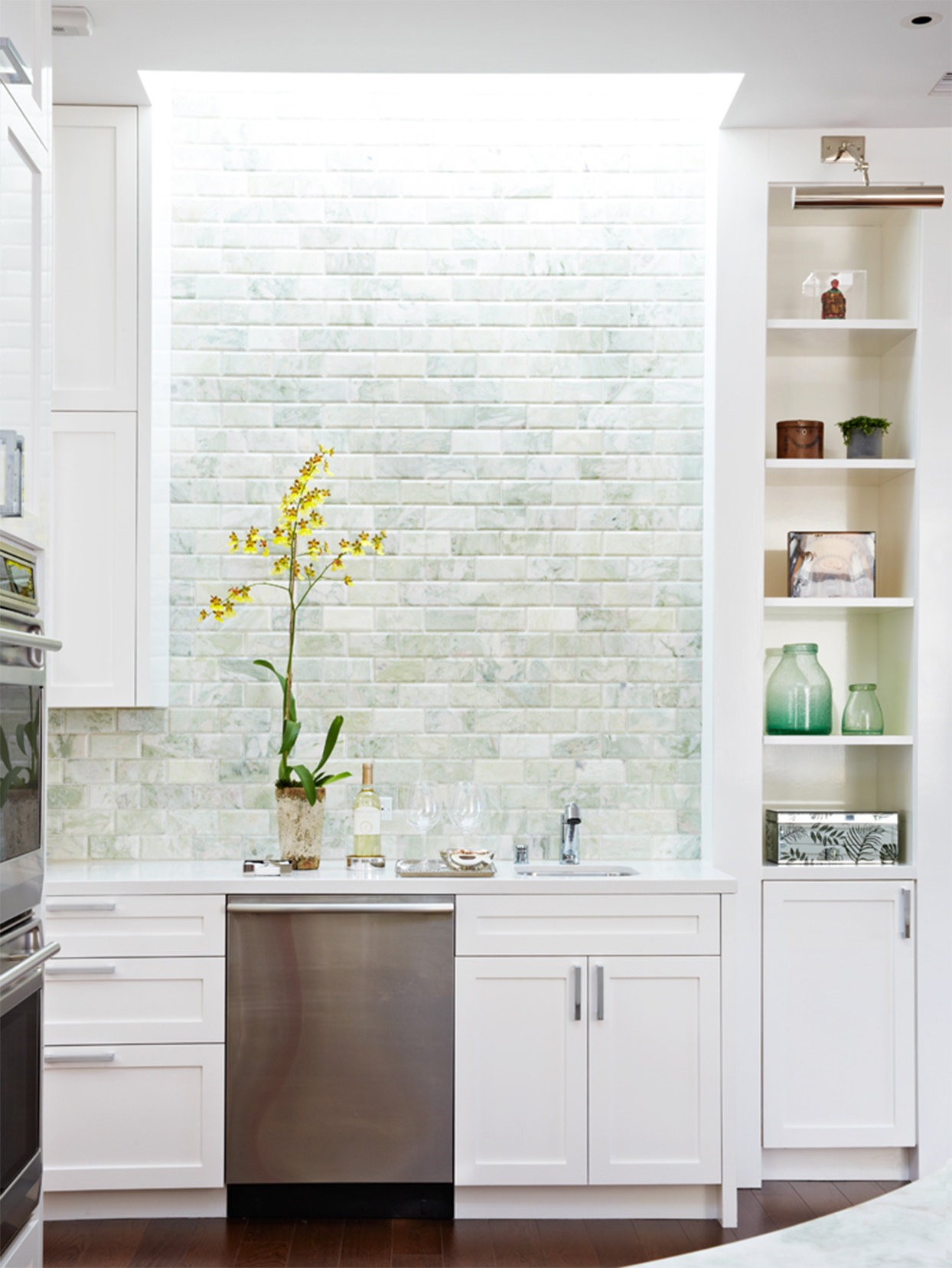 light green subway tile backsplash