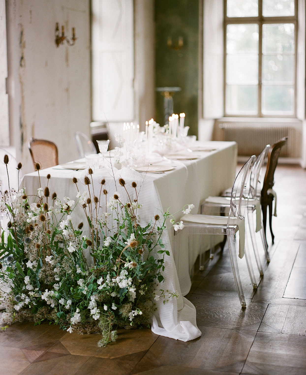 white table with floral arrangements on the floor