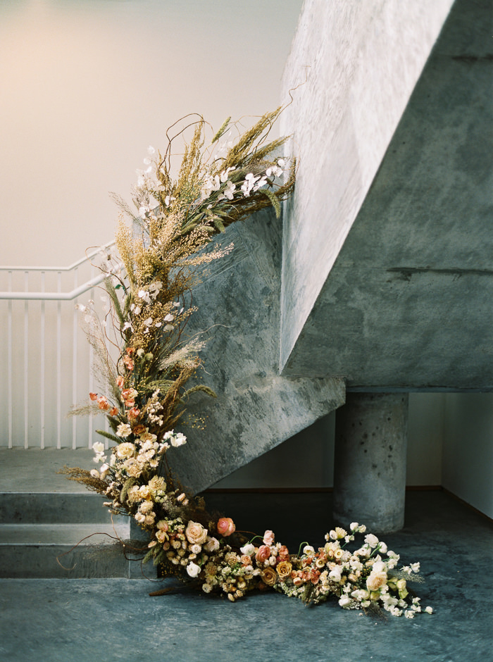 floral garland on industrial staircase