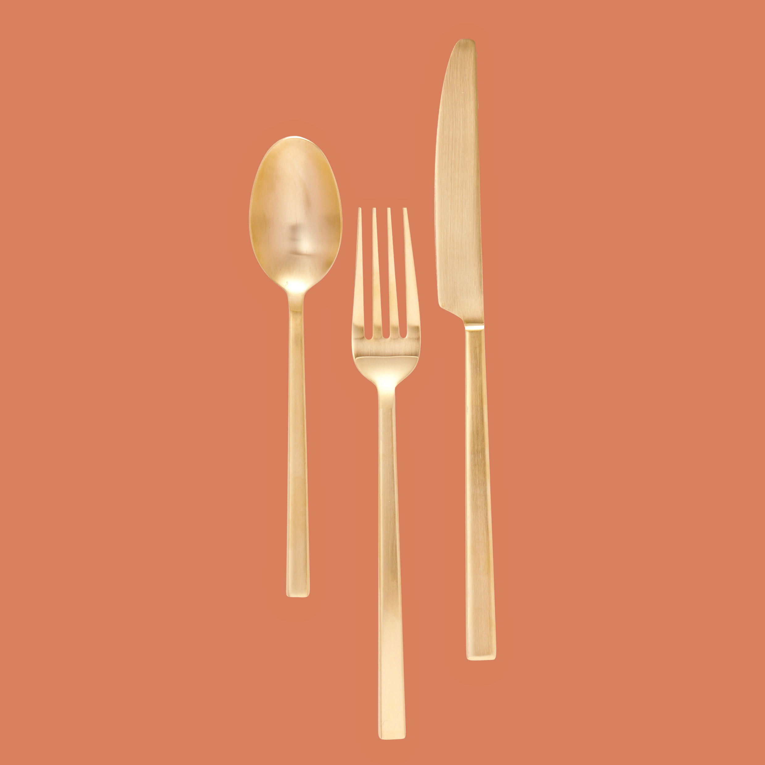 gold spoon fork knife