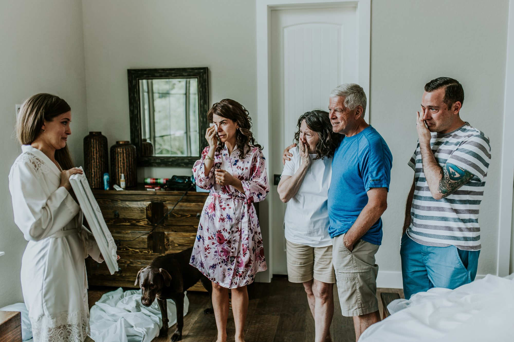 bride revealing portraits of grandma to family