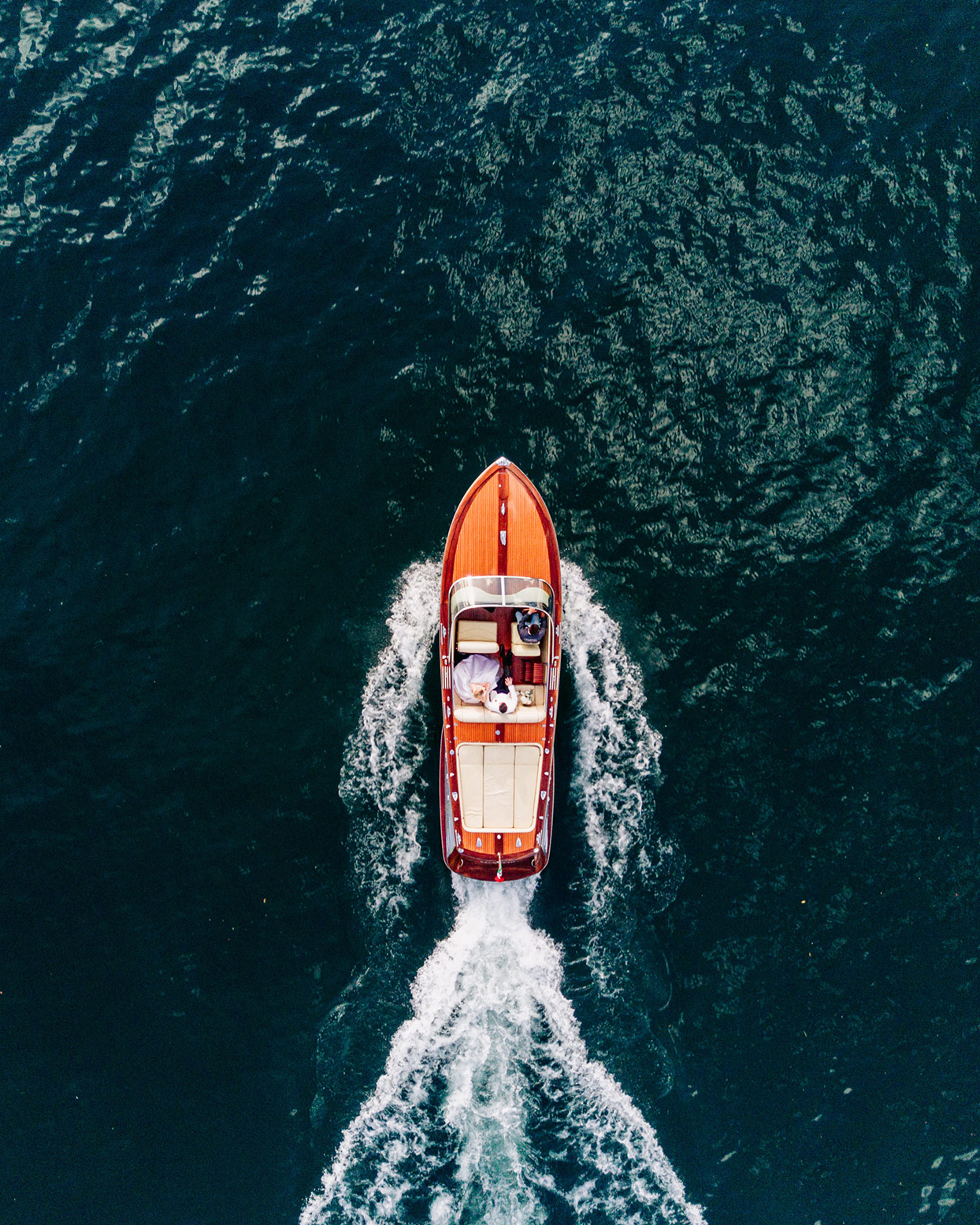arial view of kiira and arthur in wedding boat