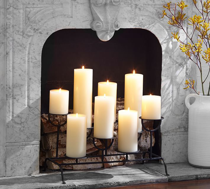 black candle holder in fireplace