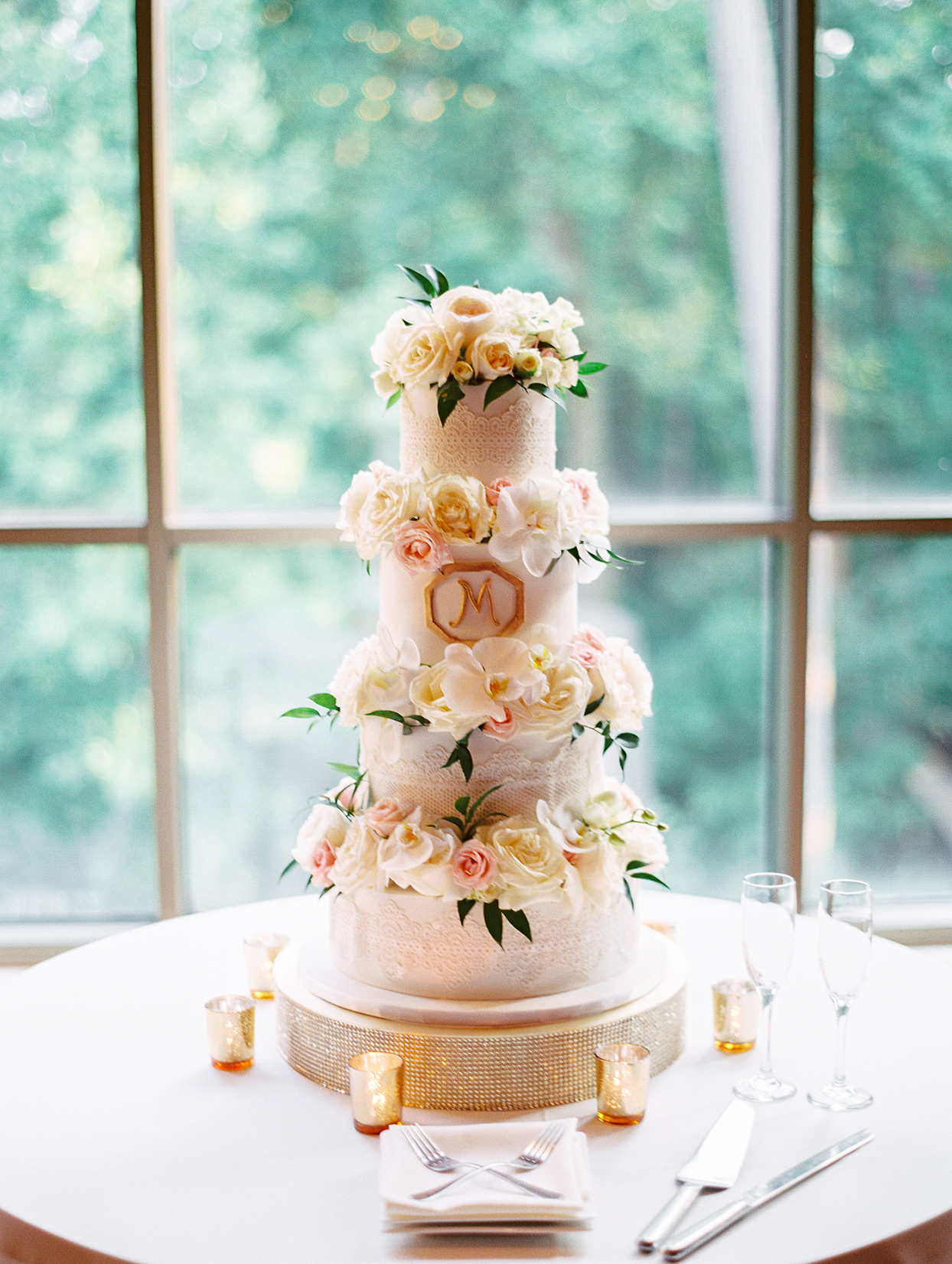 amelia justin golden and pink wedding cake by window