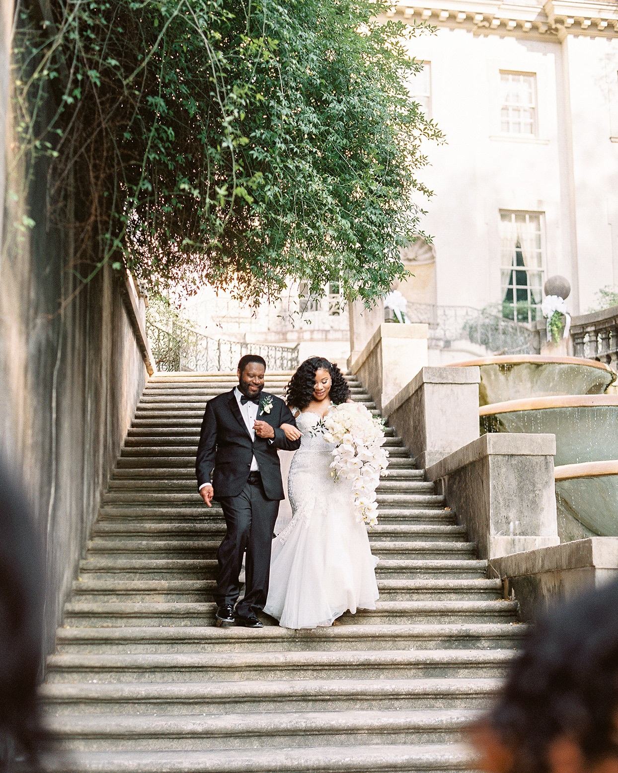 amelia justing wedding processional bride and father walking down stone steps