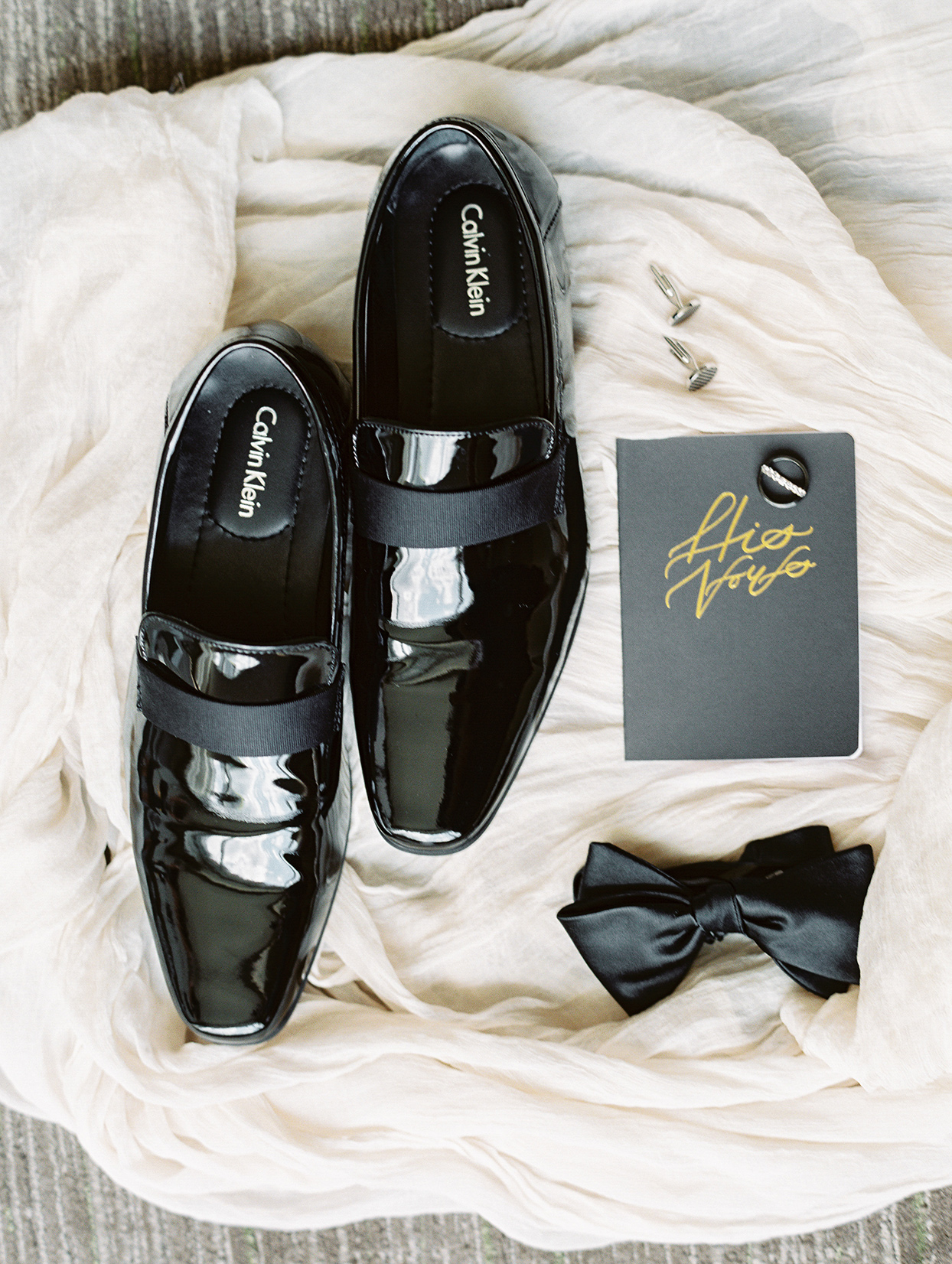 amelia justing wedding groom's shoes, bow tie and vow book