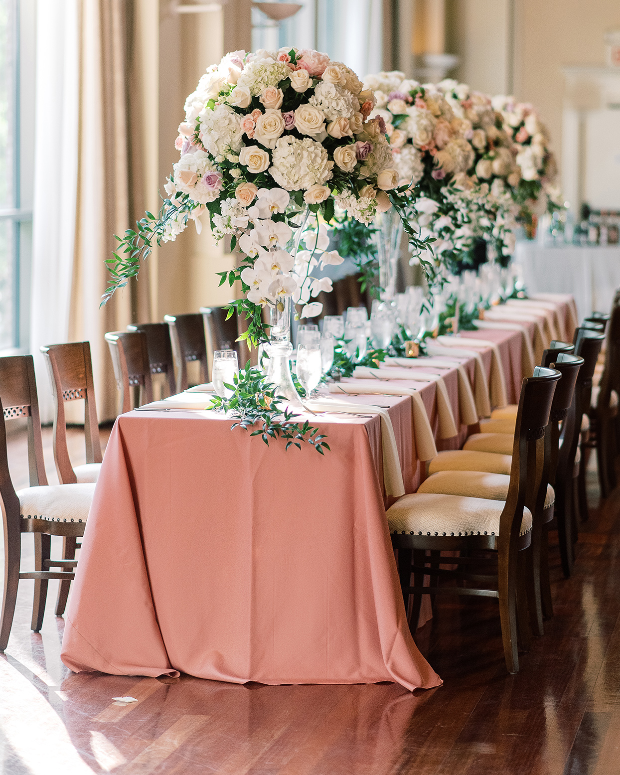 amelia justin wedding reception long table with pink cloth