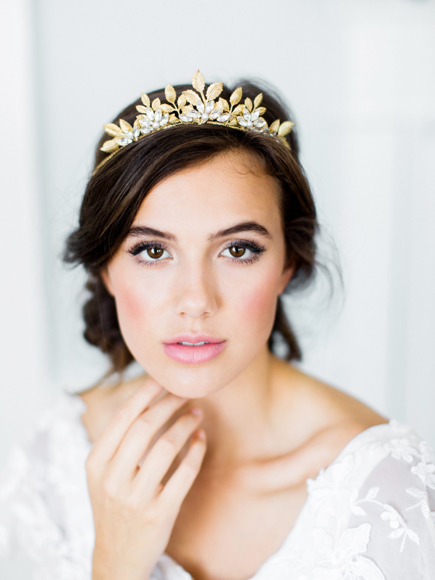 bride wearing diamond-and-gold flowers crown