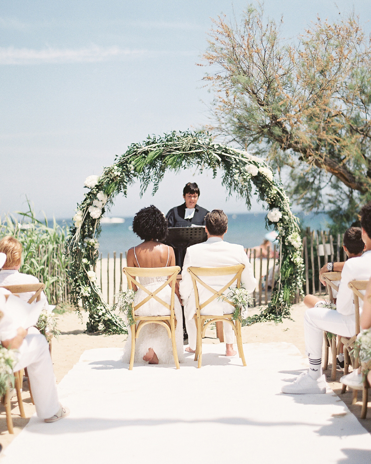 patricia ralph wedding ceremony couple sitting in chairs