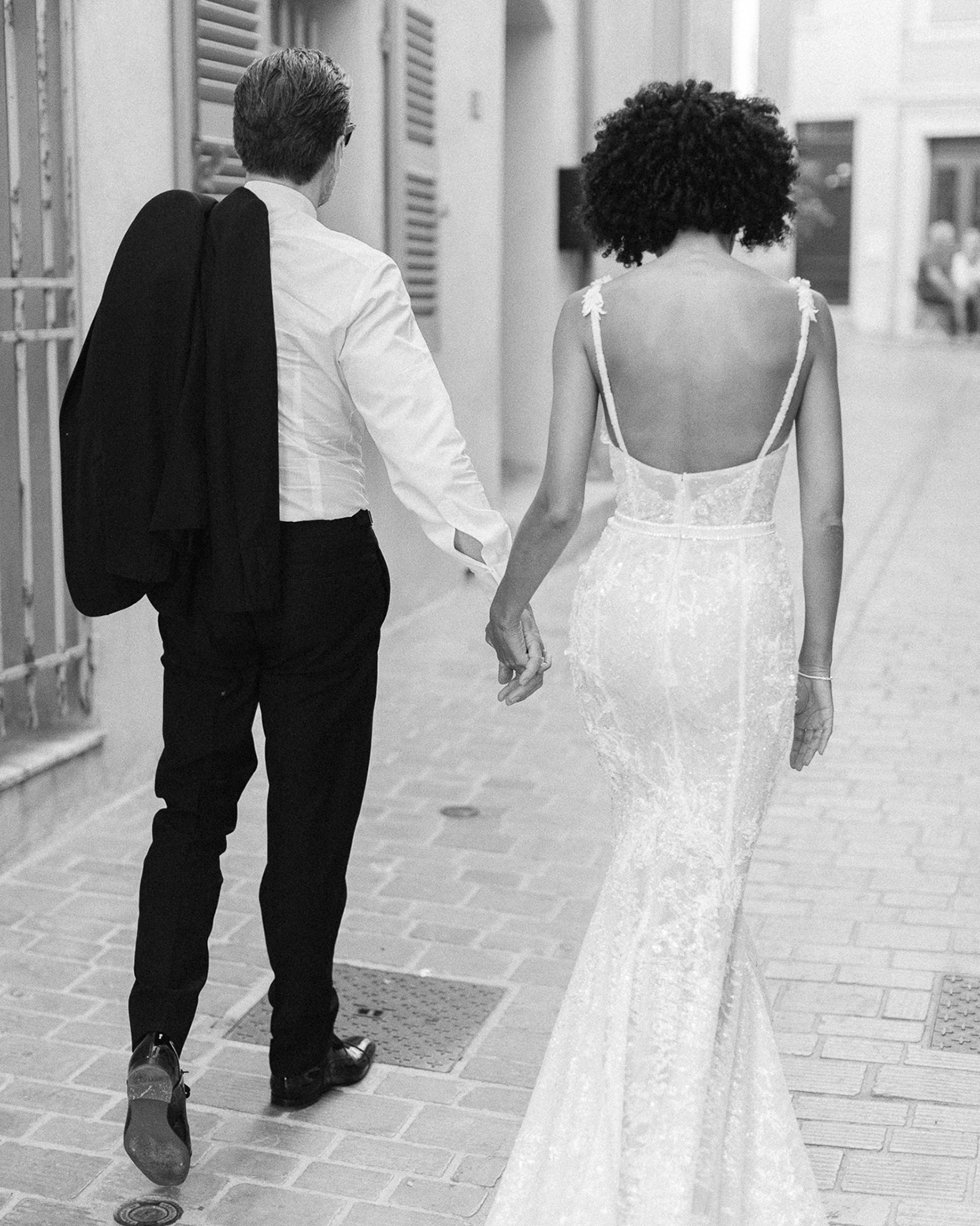 patricia ralph wedding couple holding hands walking