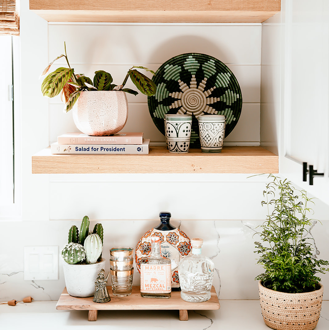 decor and plants on kitchen shelving