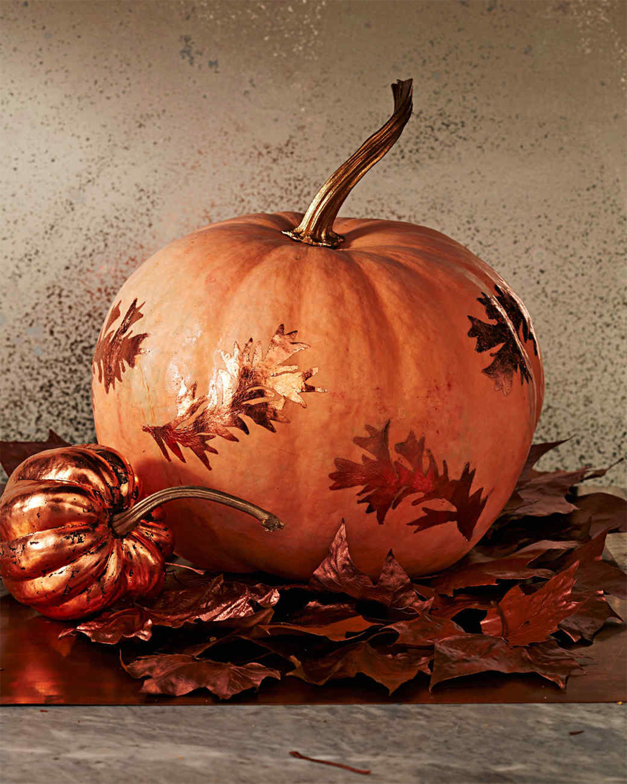 pumpkin decorated with gilded leaves