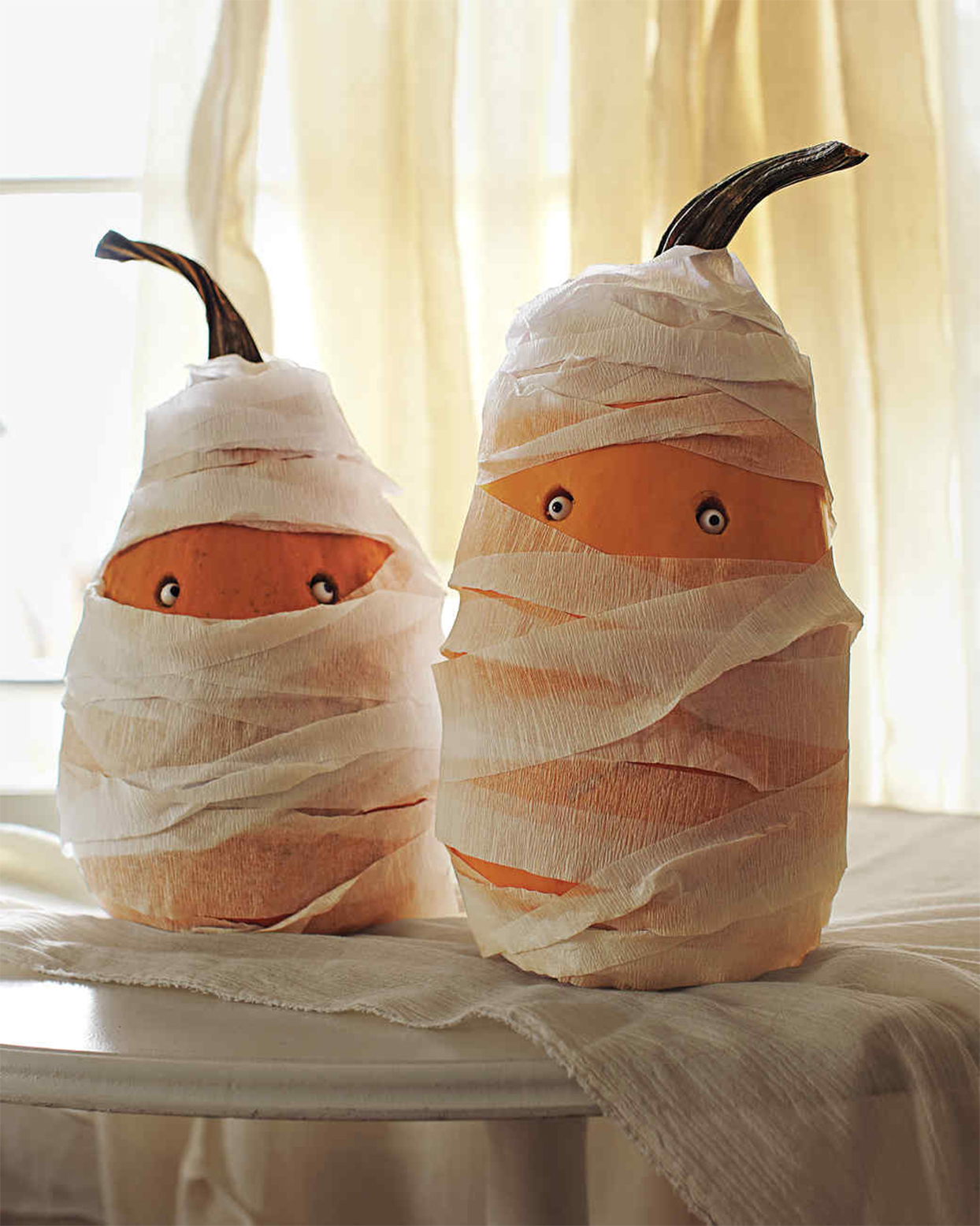 wrapped pumpkins resembling mummies