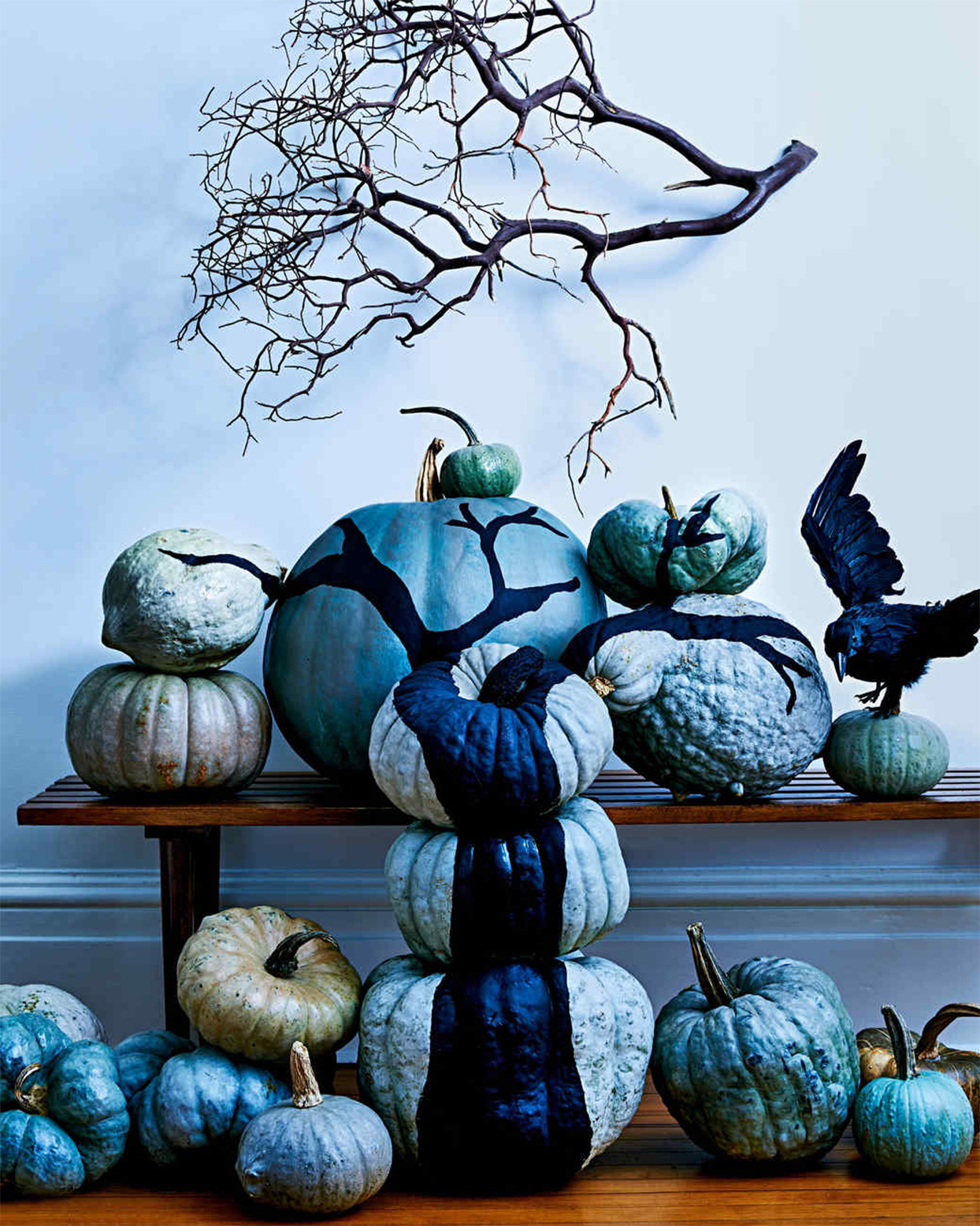 painted pumpkins stacked to form a tree