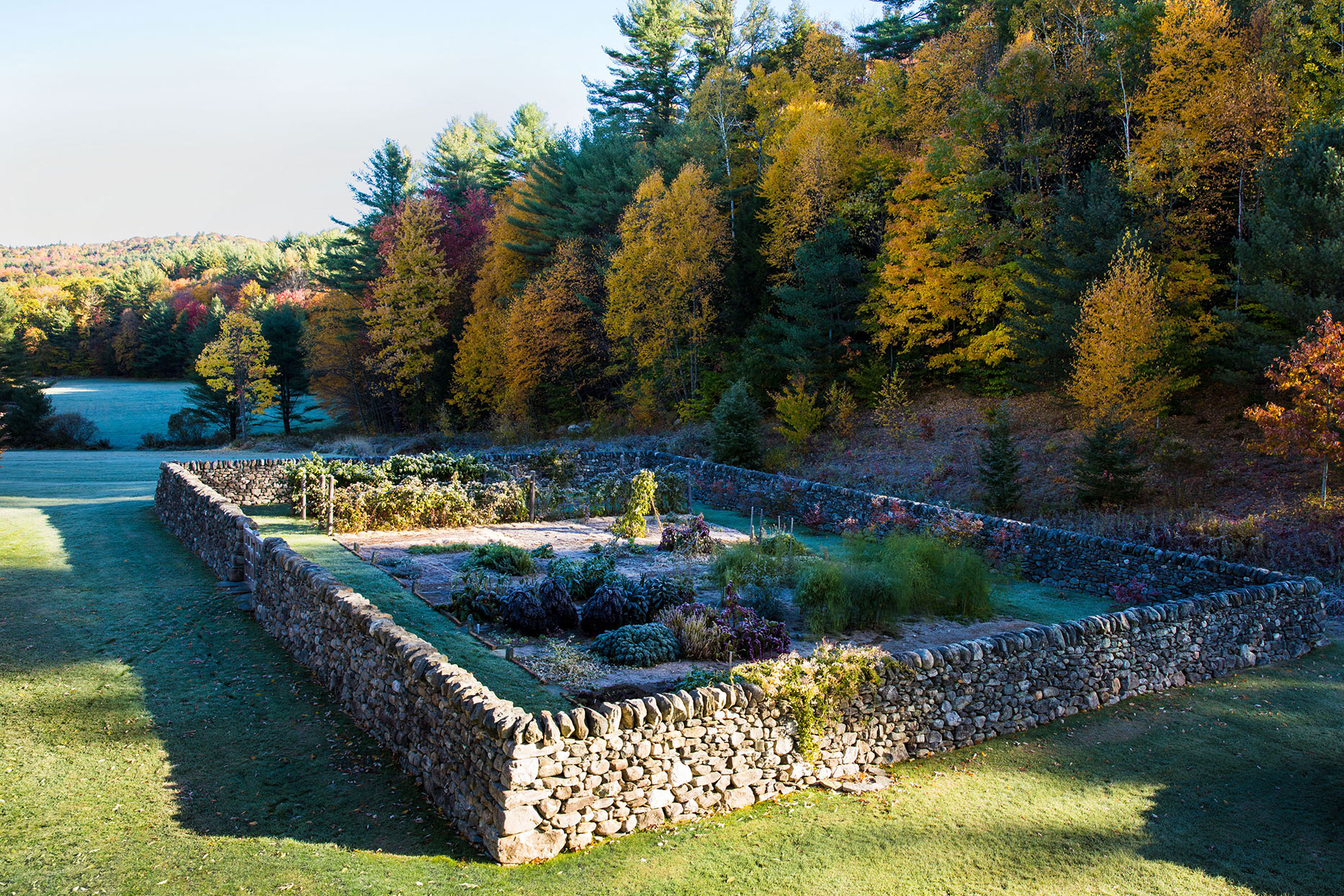 rock wall around garden in fall