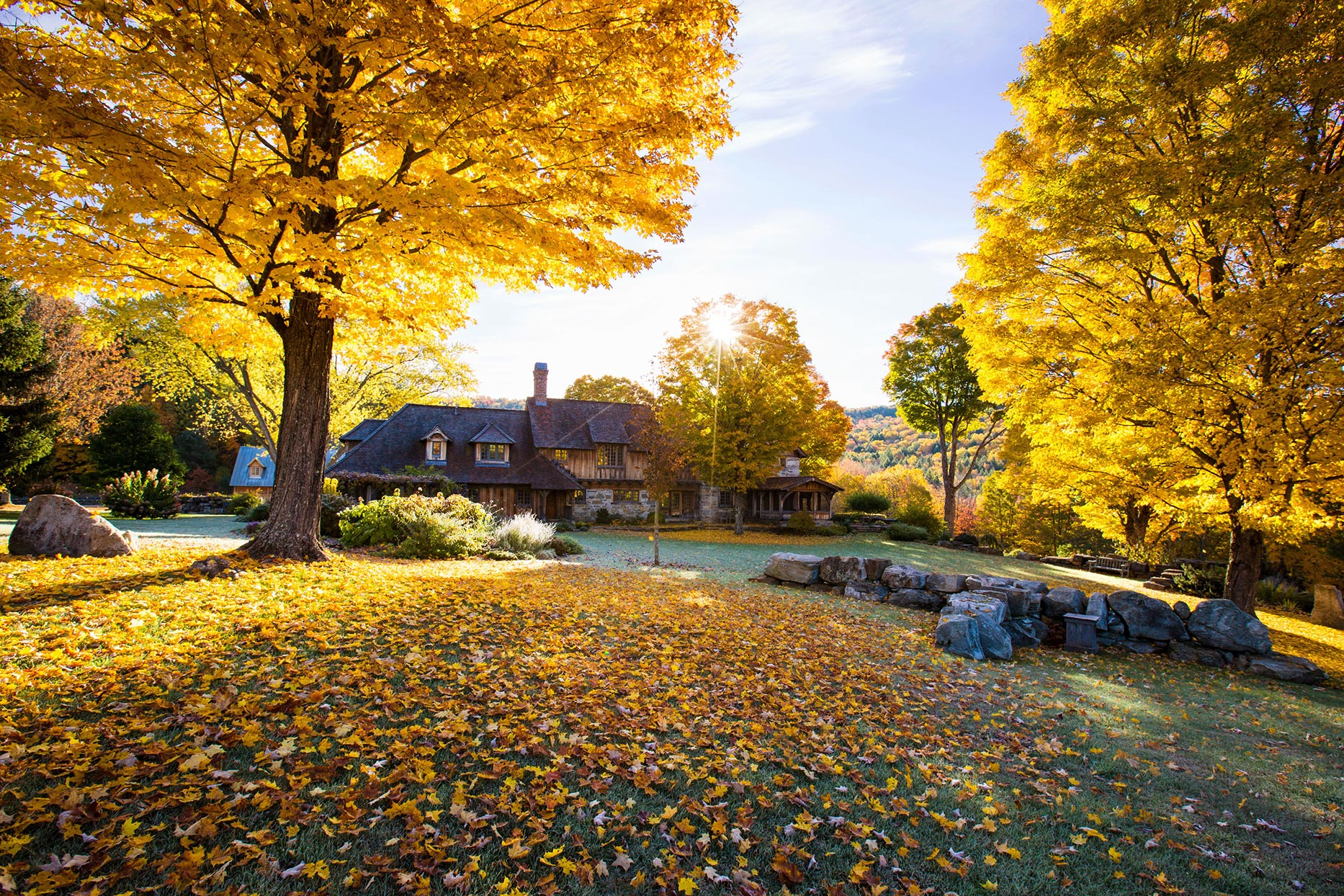 wide view of vermont house in fall