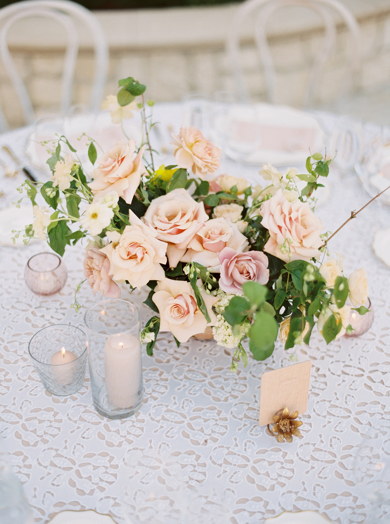table centerpiece blush buttercup blooms lace table cloth