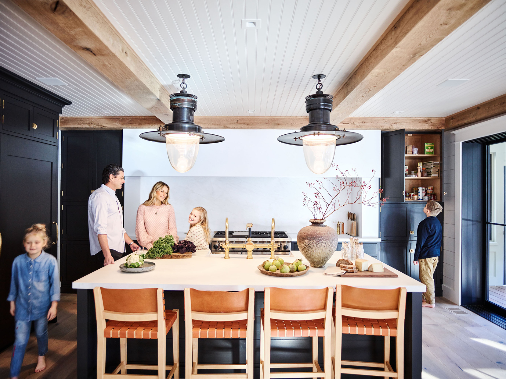 family in kitchen of cape cod home
